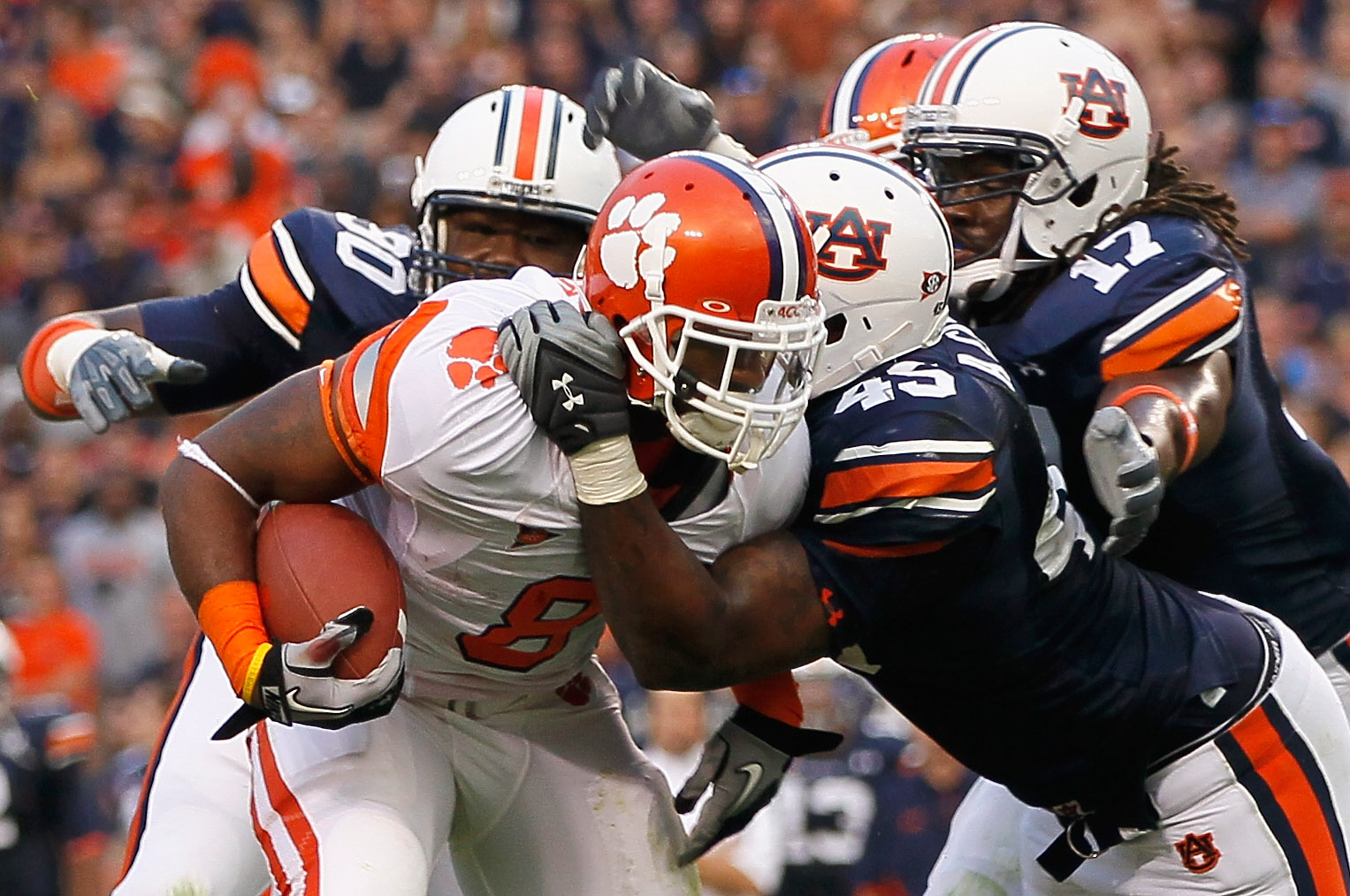 AUBURN, AL - SEPTEMBER 18:  Jamie Harper #8 of the Clemson Tigers is tackled by Nick Fairley #90, Antoine Carter #45 and Josh Bynes #17 of the Auburn Tigers at Jordan-Hare Stadium on September 18, 2010 in Auburn, Alabama.  (Photo by Kevin C. Cox/Getty Ima