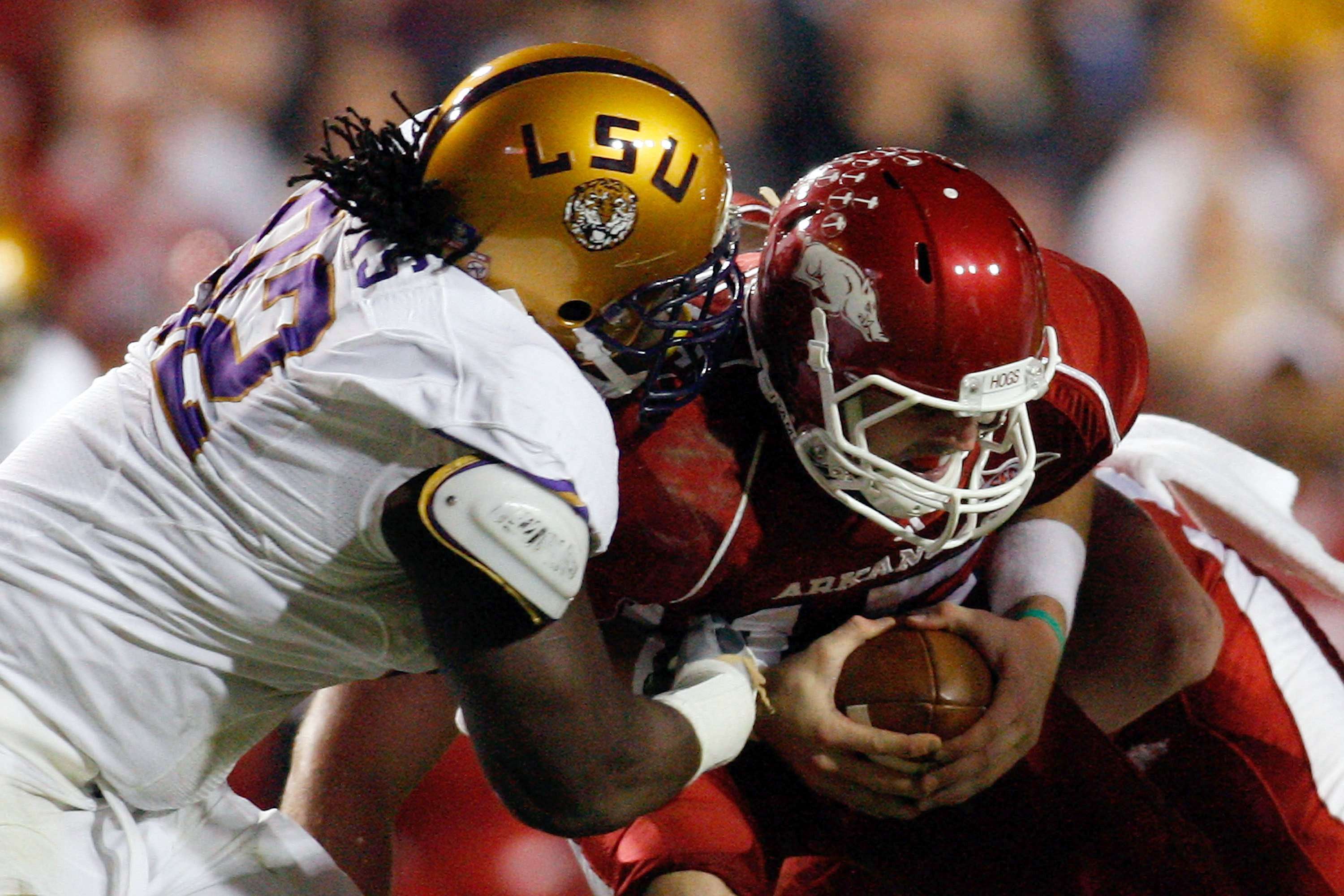 BATON ROUGE, LA - NOVEMBER 28:  Quarterback Ryan Mallett #15 of the Arkansa Razorbacks is sacked by Drake Nevis #92 of the Louisiana State University Tigers at Tiger Stadium on November 28, 2009 in Baton Rouge, Louisiana.  (Photo by Chris Graythen/Getty I
