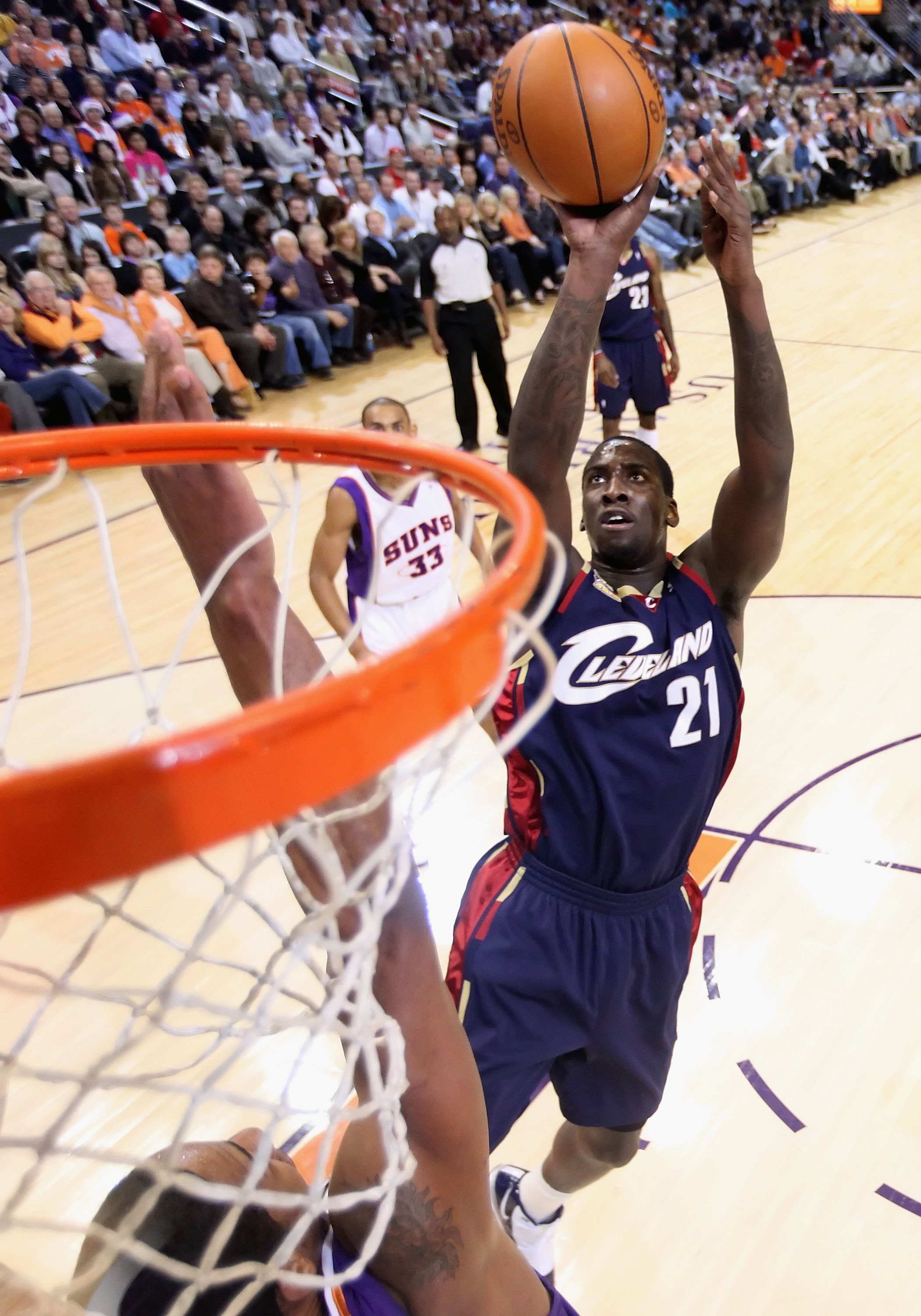 PHOENIX - DECEMBER 21:  J.J. Hickson #21 of the Cleveland Cavaliers puts up a shot over Channing Frye #8 of the Phoenix Suns during the NBA game at US Airways Center on December 21, 2009 in Phoenix, Arizona. The Cavaliers defeated the Suns 109-91.  NOTE T
