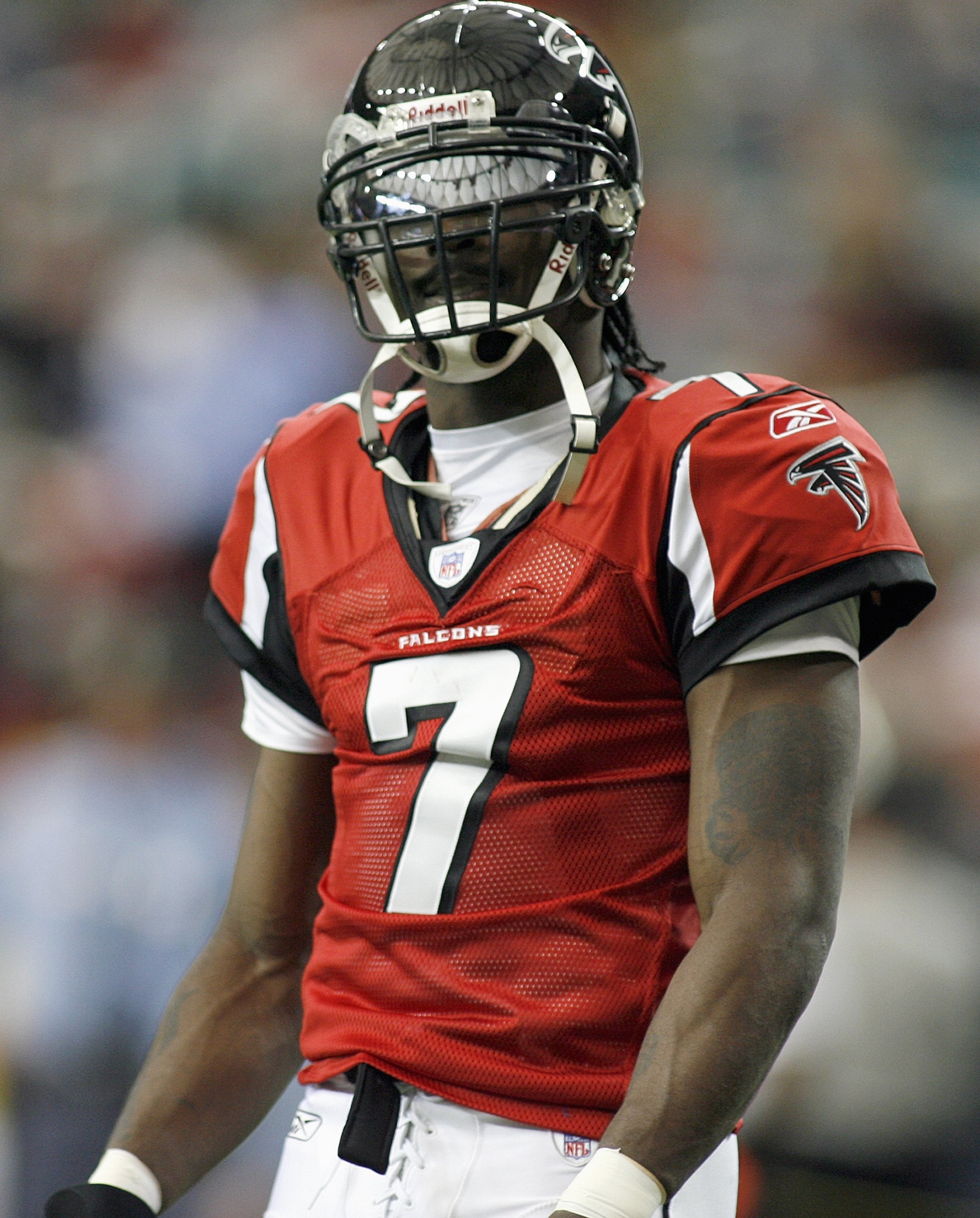 ATLANTA - DECEMBER 24: Quarterback Michael Vick #7 of the Atlanta Falcons looks on during the game against the Carolina Panthers on December 24, 2006 at The Georgia Dome in Atlanta,Georgia. (Photo by Marc Serota/Getty Images)