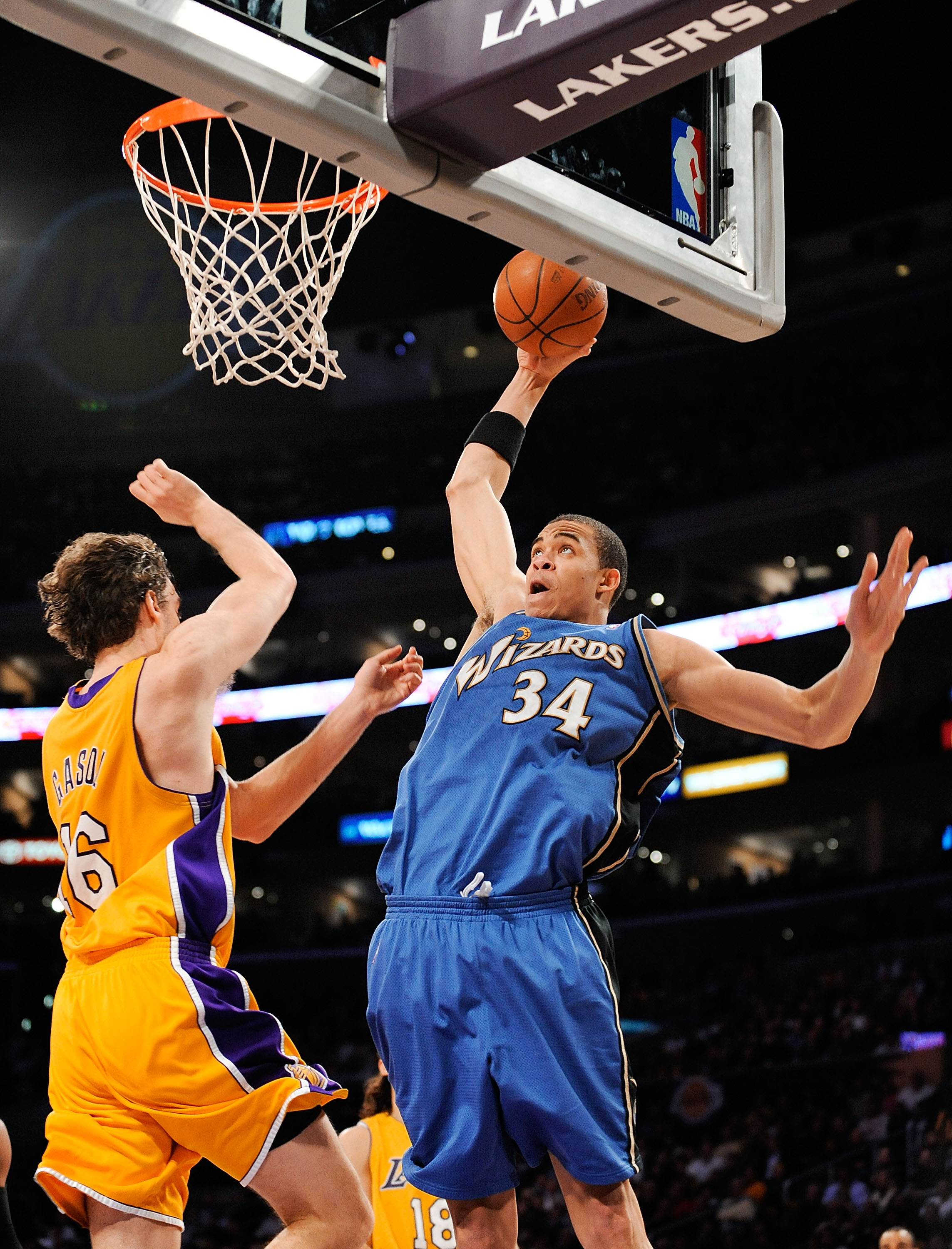 LOS ANGELES, CA - JANUARY 22: JaVale McGee #34 of the Washington Wizards slams the ball against Pau Gasol of the Los Angeles Lakers during the second quarter at the Staples Center January 22, 2009 in Los Angeles, California. NOTE TO USER: User expressly a