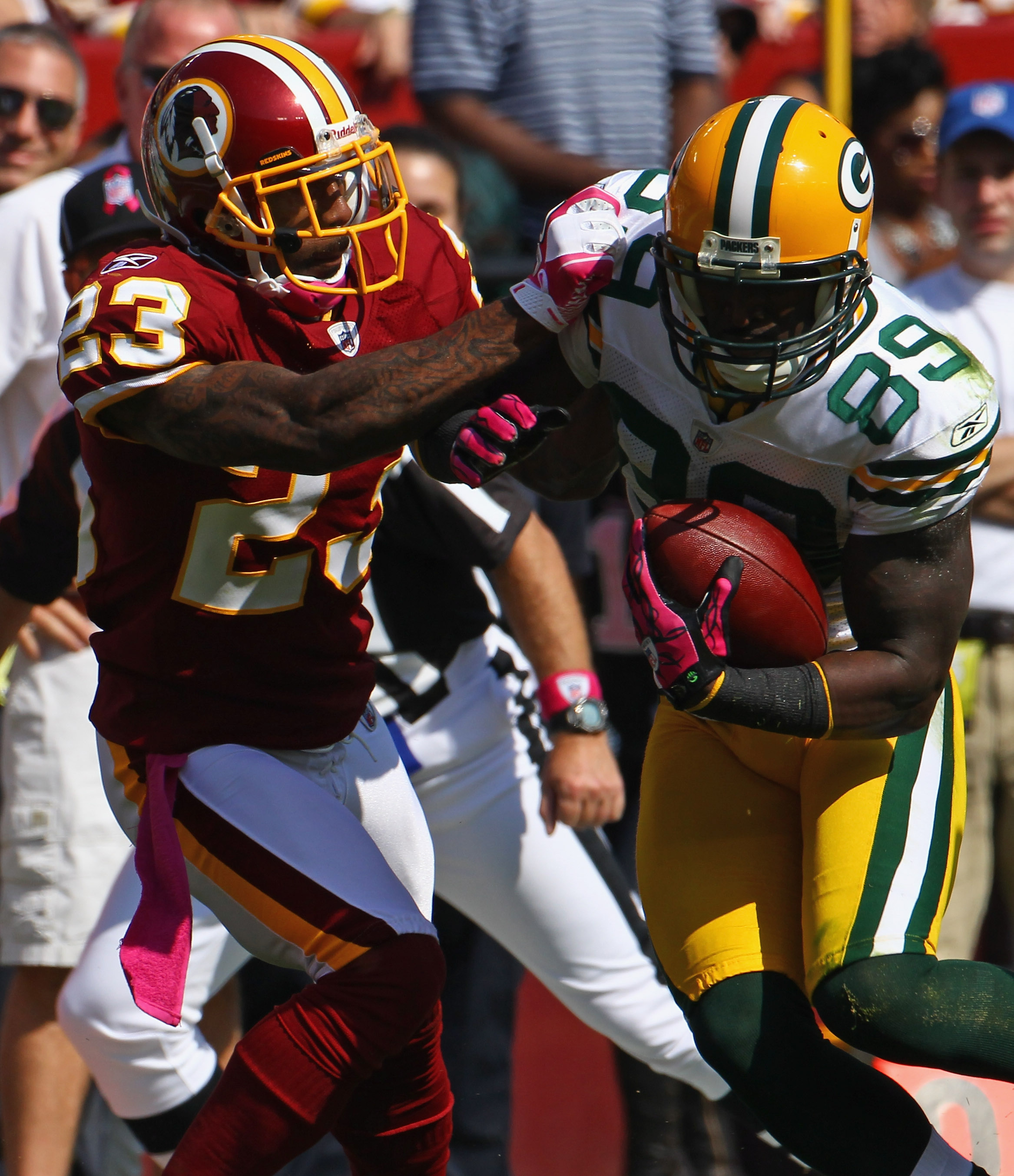 LANDOVER, MD - OCTOBER 10: Wide receiver James Jones #89 of the Green Bay Packers is tackled by cornerback DeAngelo Hall #23 the Washington Redskins at FedExField on October 10, 2010 in Landover, Maryland.  (Photo by Win McNamee/Getty Images)