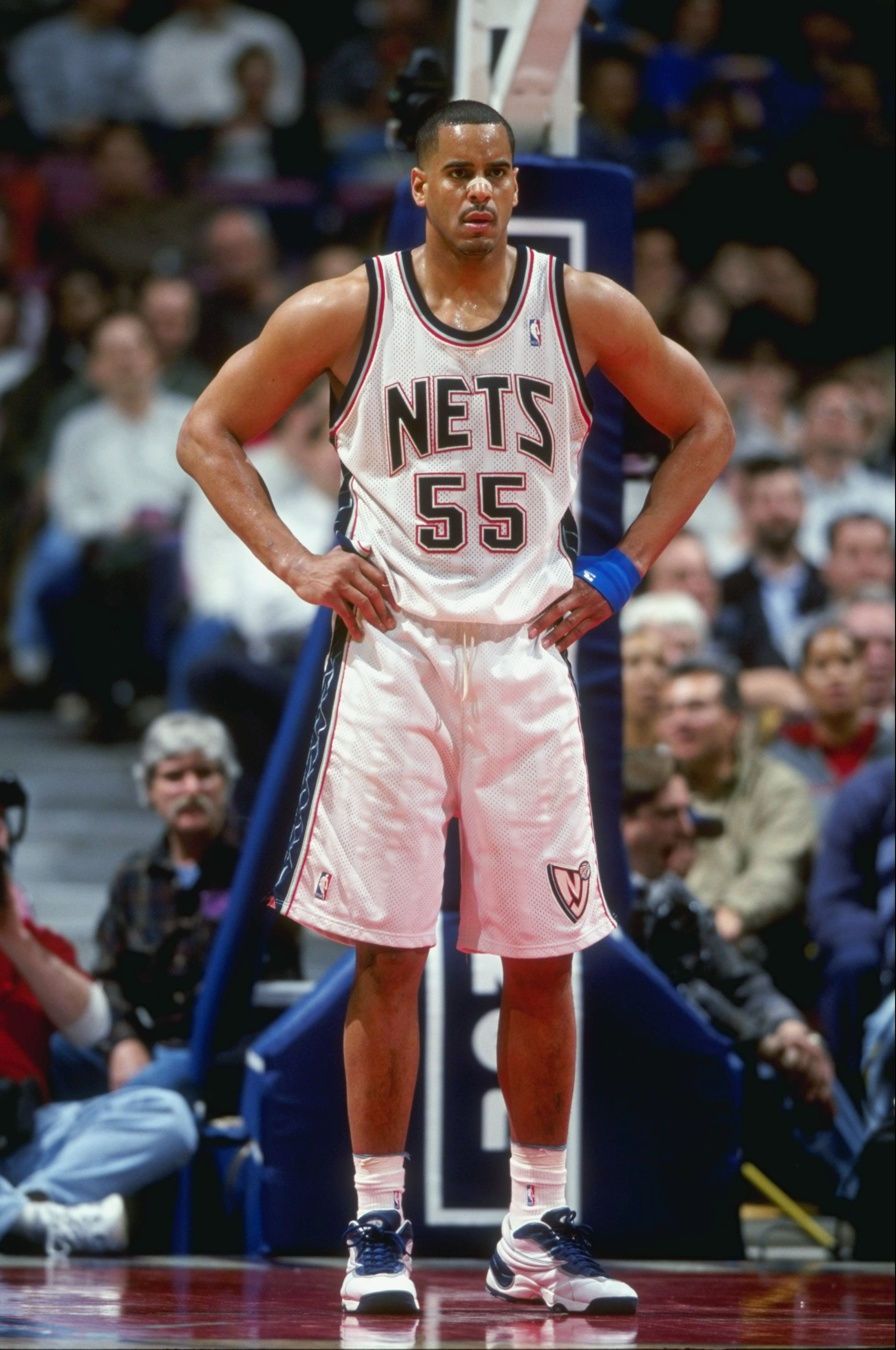 24 Mar 1999: Jayson Williams #55 of the New Jersey Nets stands under the basket as he waits during a game against the Detroit Pistons at the Continental Airlines Arena in East Rutherford, New Jersey. The Pistons defeated the Nets 84-71.