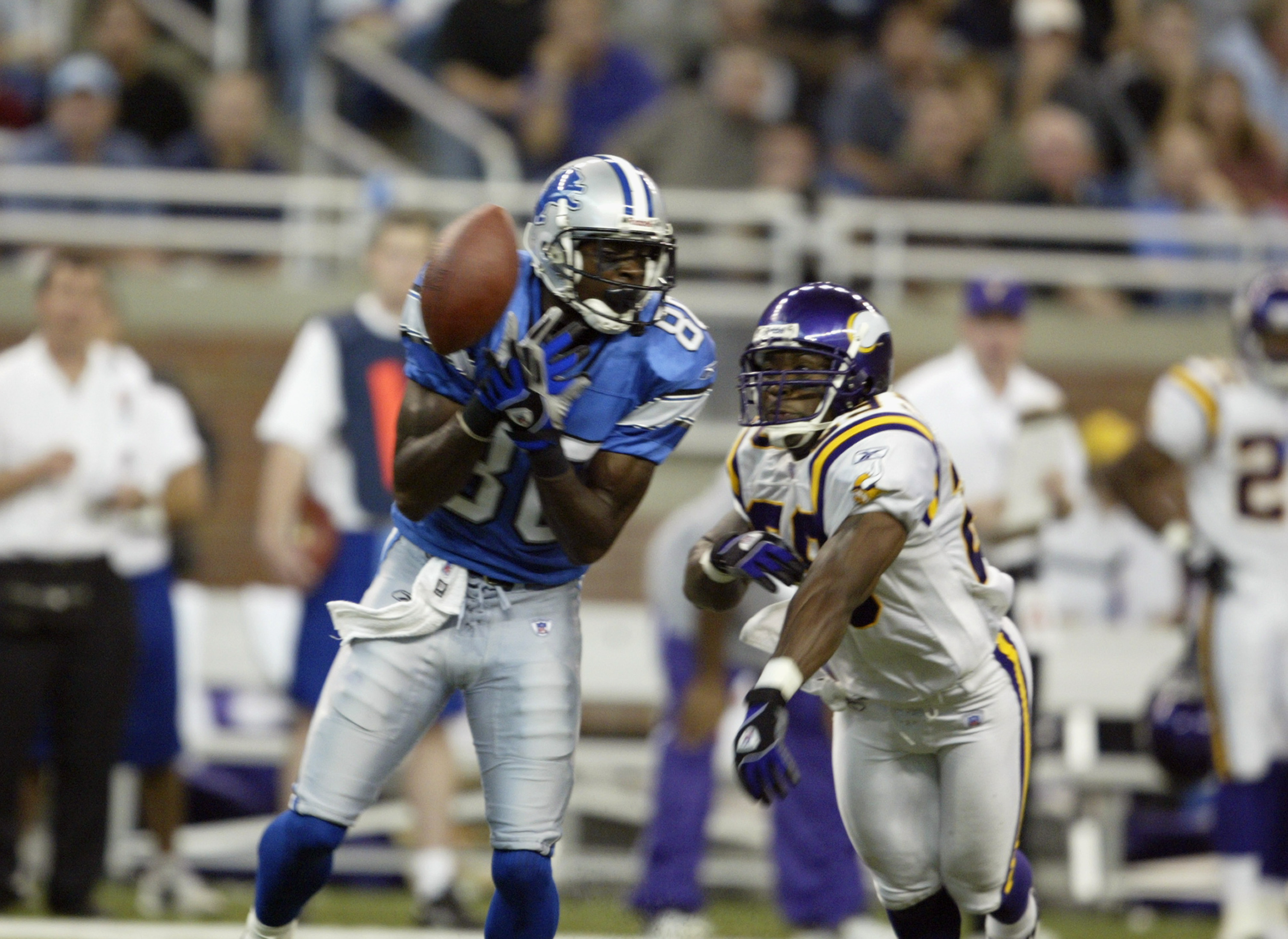 DETROIT - SEPTEMBER 21:  Wide receiver Charles Rogers #80 of the Detroit Lions fails to catch a pass while being defended by linebacker Mike Nattiel #59 of the Minnesota Vikings at Ford Field on September 21, 2003 in Detroit, Michigan. The Vikings defeate