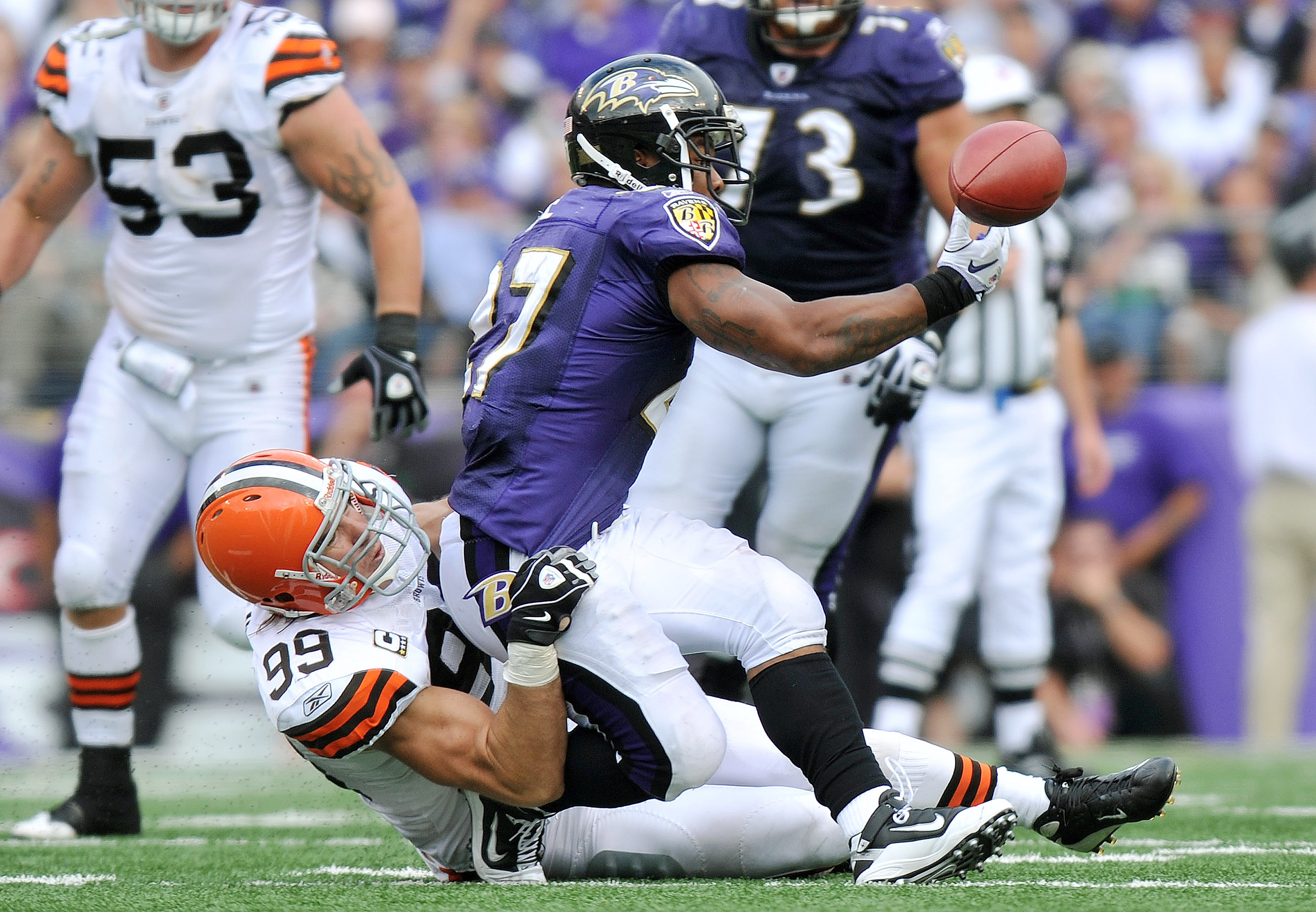 BALTIMORE - SEPTEMBER 26:  Ray Rice #27 of the Baltimore Ravens can't hold onto a pass as he's taken down by Scott Fujita #99 of the Cleveland Browns  at M&T Bank Stadium on September 26, 2010 in Baltimore, Maryland. The Ravens defeated the Browns 24-17.