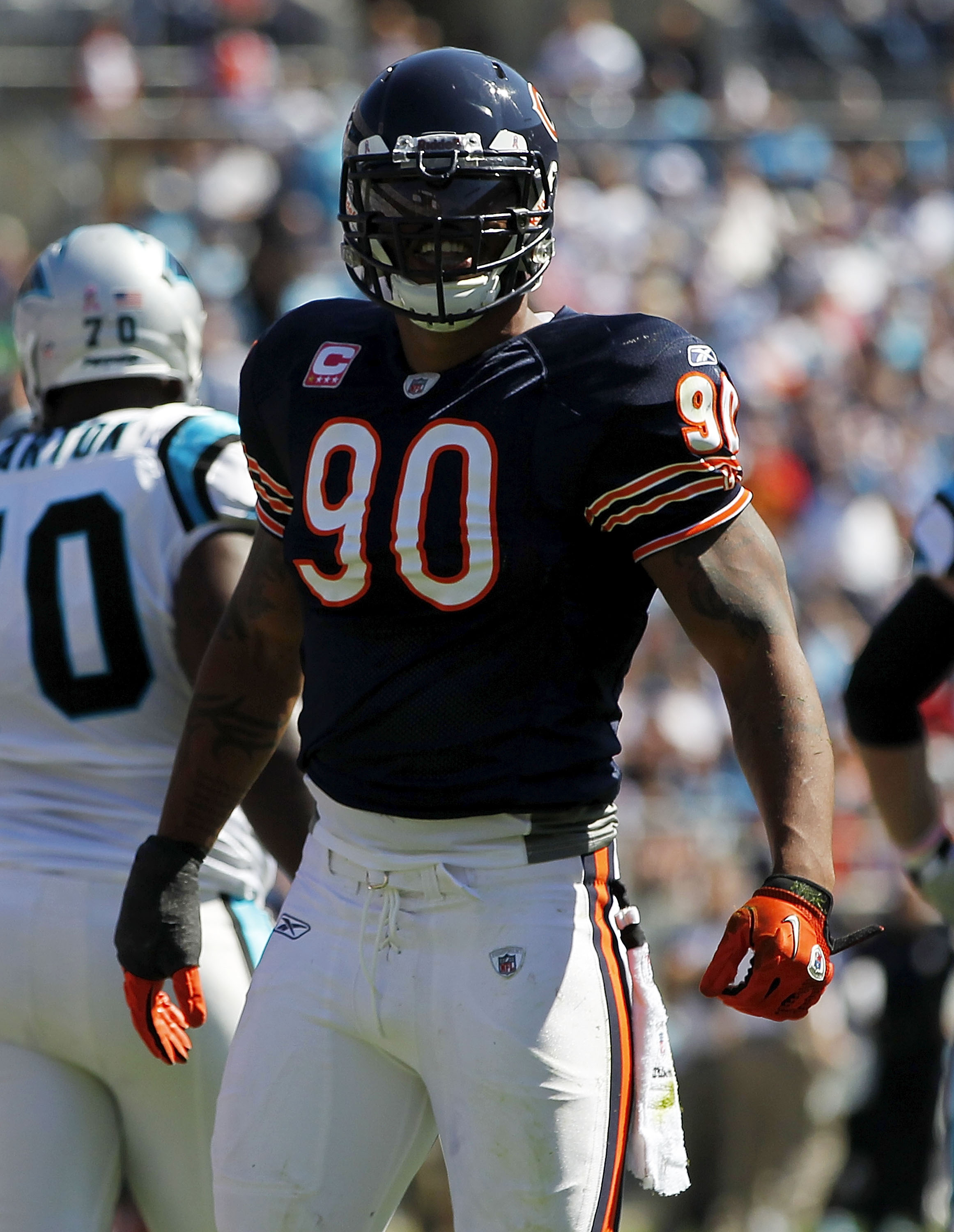 CHARLOTTE, NC - OCTOBER 10: Defensive end Julius Peppers #90 of the Chicago Bears stands on the field against the Carolina Panthers at Bank of America Stadium on October 10, 2010 in Charlotte, North Carolina. (Photo by Geoff Burke/Getty Images)