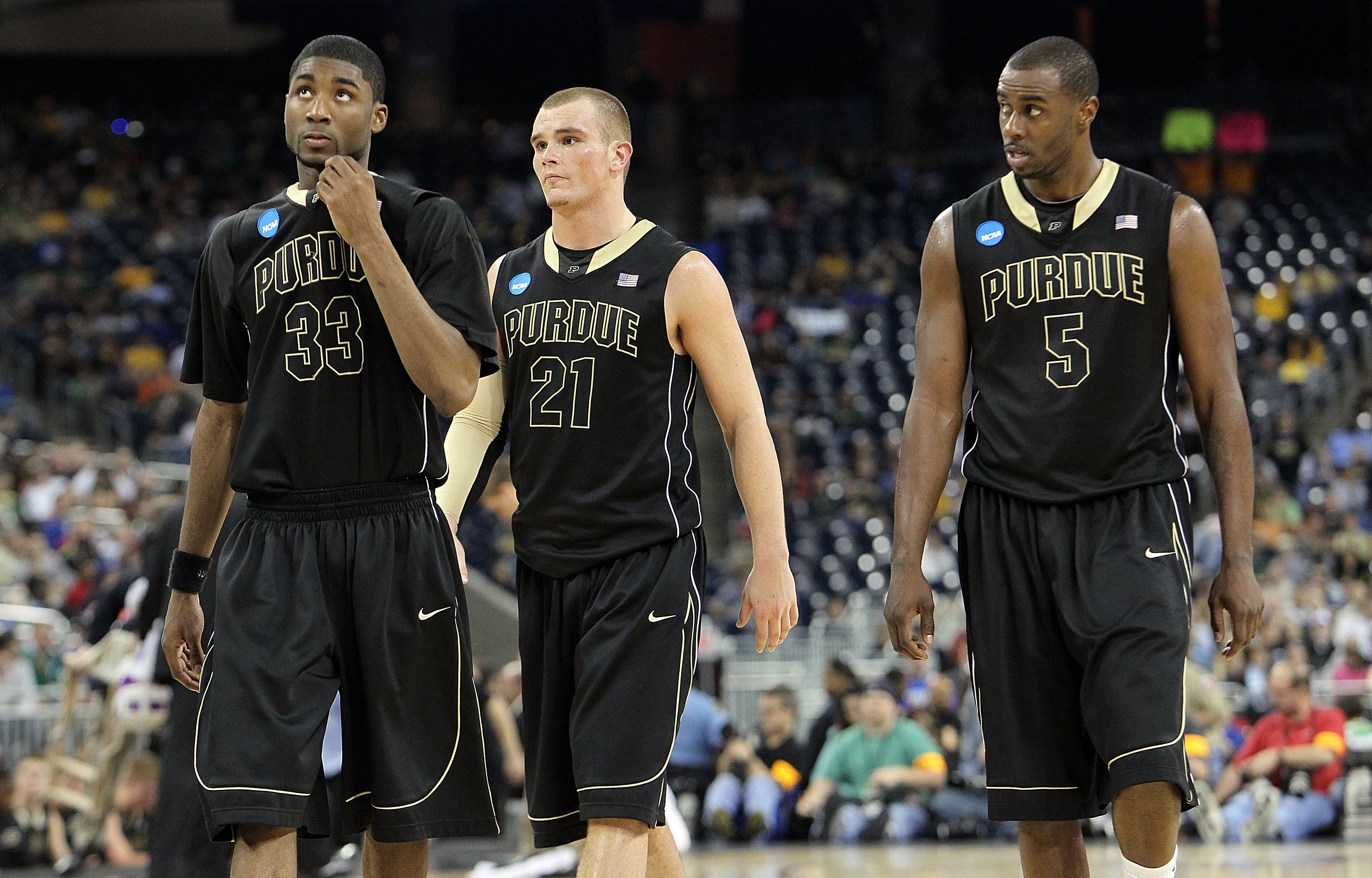 HOUSTON - MARCH 26: (L-R) E'Twaun Moore #33, D.J. Byrd #21 and Keaton Grant #5 of the Purdue Boilermakers during a 70-57 loss against the Duke Blue Devils during the south regional semifinal of the 2010 NCAA men's basketball tournament at Reliant Stadium