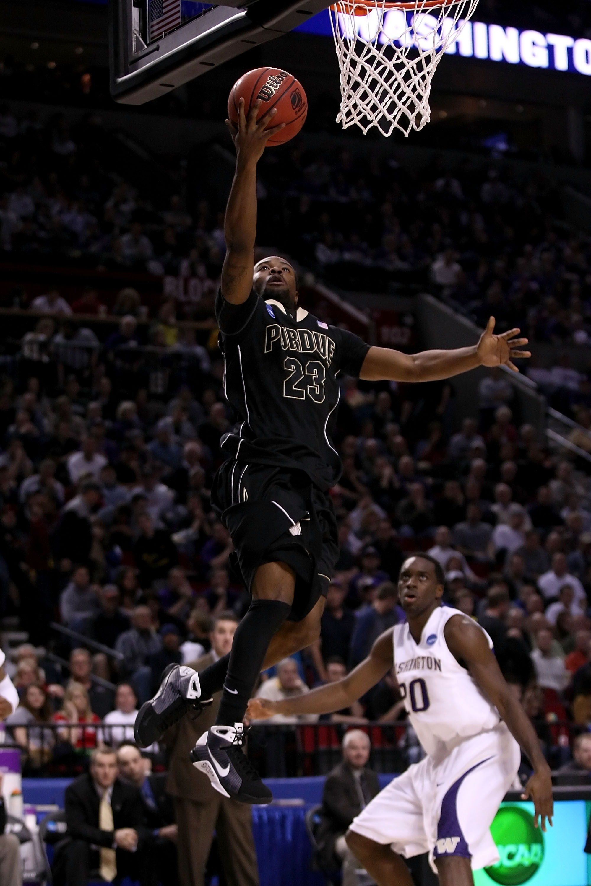 PORTLAND, OR - MARCH 21:  Lewis Jackson #23 of the Purdue Boilermakers goes up for a layup as Quincy Pondexter #20 of the Washington Huskies looks on during the second round of the NCAA Division I Men's Basketball Tournament at the Rose Garden on March 21