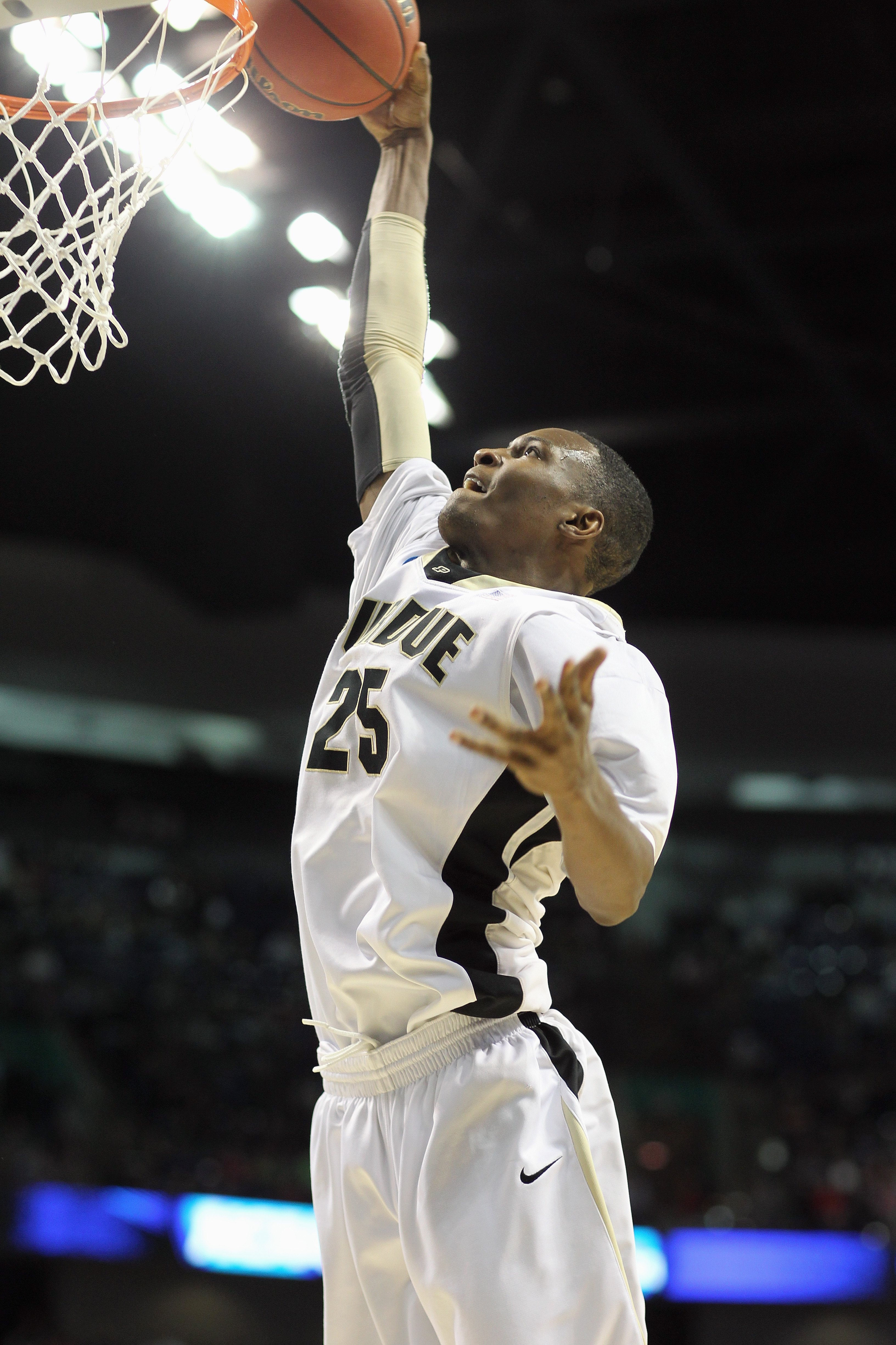 SPOKANE,WA - MARCH 21: JaJuan Johnson #25 of the Purdue Boilermakers dunks the ball against the Texas A&M Aggies during the second round of the 2010 NCAA men's basketball tournament at the Spokane Arena on March 21, 2010 in Spokane, Washington. Purdue def