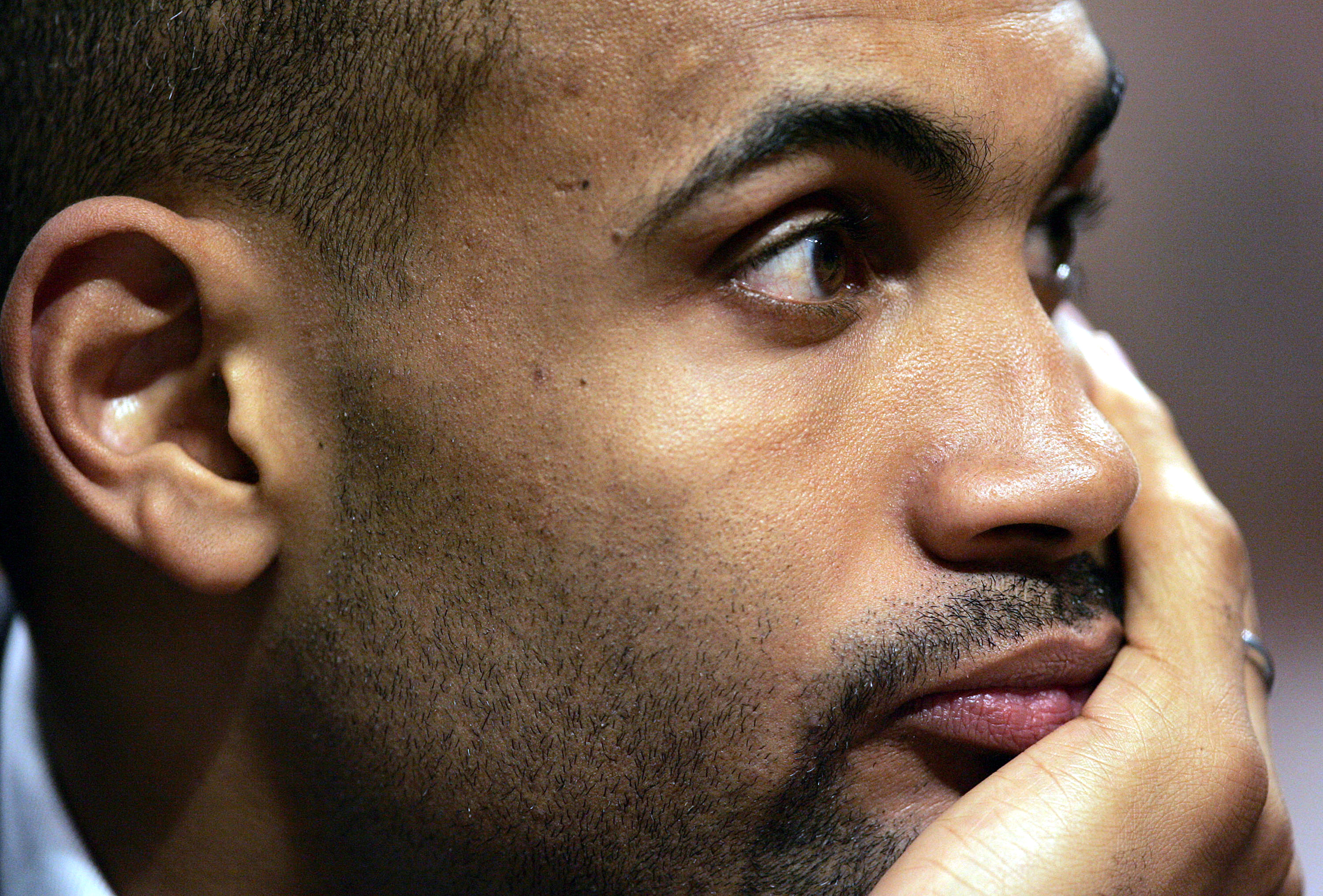 CHICAGO - APRIL 15:  Grant Hill of the Orlando Magic watches his team take on the Chicago Bulls from the bench on April 15, 2005 at the United Center in Chicago, Illinois. The Bulls defeated the Magic 117-77.  NOTE TO USER: User expressly acknowledges and