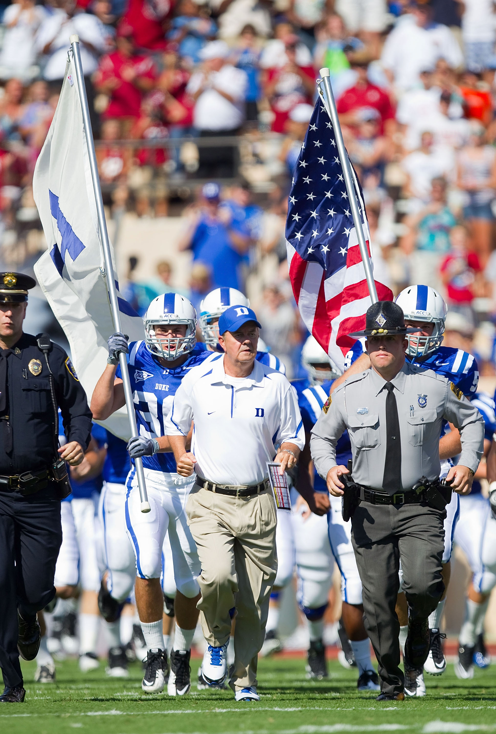 DURHAM, NC - SEPTEMBER 18: Duke Blue Devils head coach David Cutcliffe (C) leads his team on to the field to take on the Alabama Crimson Tide at Wallace Wade Stadium on September 18, 2010 in Durham, North Carolina.  The Crimson Tide defeated the Blue Devi