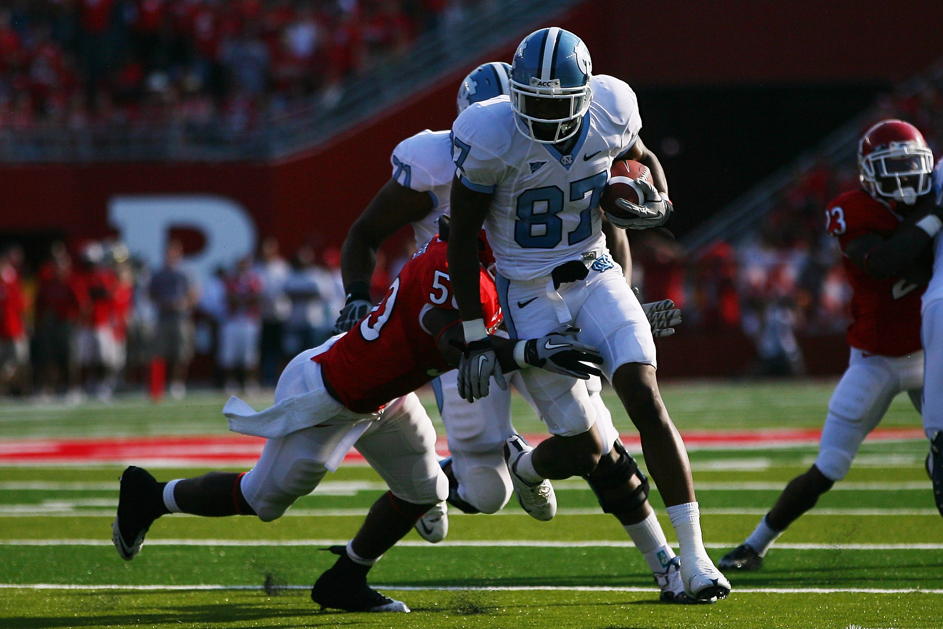 NEW BRUNSWICK, NJ - SEPTEMBER 25:  Jheranie Boyd #87 of the North Carolina Tar Heels breaks the tackle of Antonio Lowery #50 of the Rutgers Scarlet Knights during the second quarter at Rutgers Stadium on September 25, 2010 in New Brunswick, New Jersey.  (