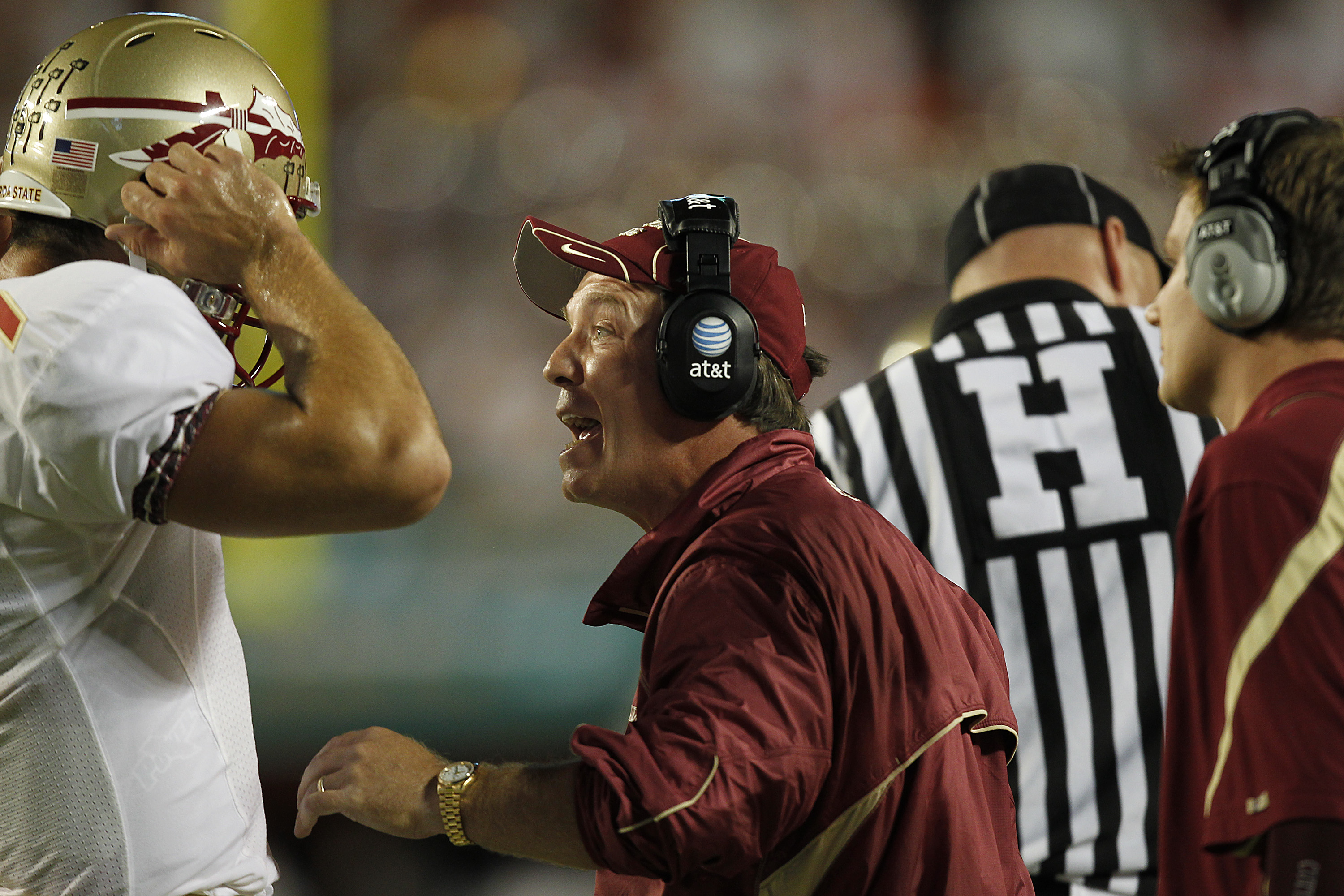 MIAMI, FL - OCTOBER 9: Head coach Jimbo Fisher talks to Christian Ponder #7 of the Florida State Seminoles during first half action against the Miami Hurricanes on October 9, 2010 at Sun Life Stadium in Miami, Florida. (Photo by Joel Auerbach/Getty Images