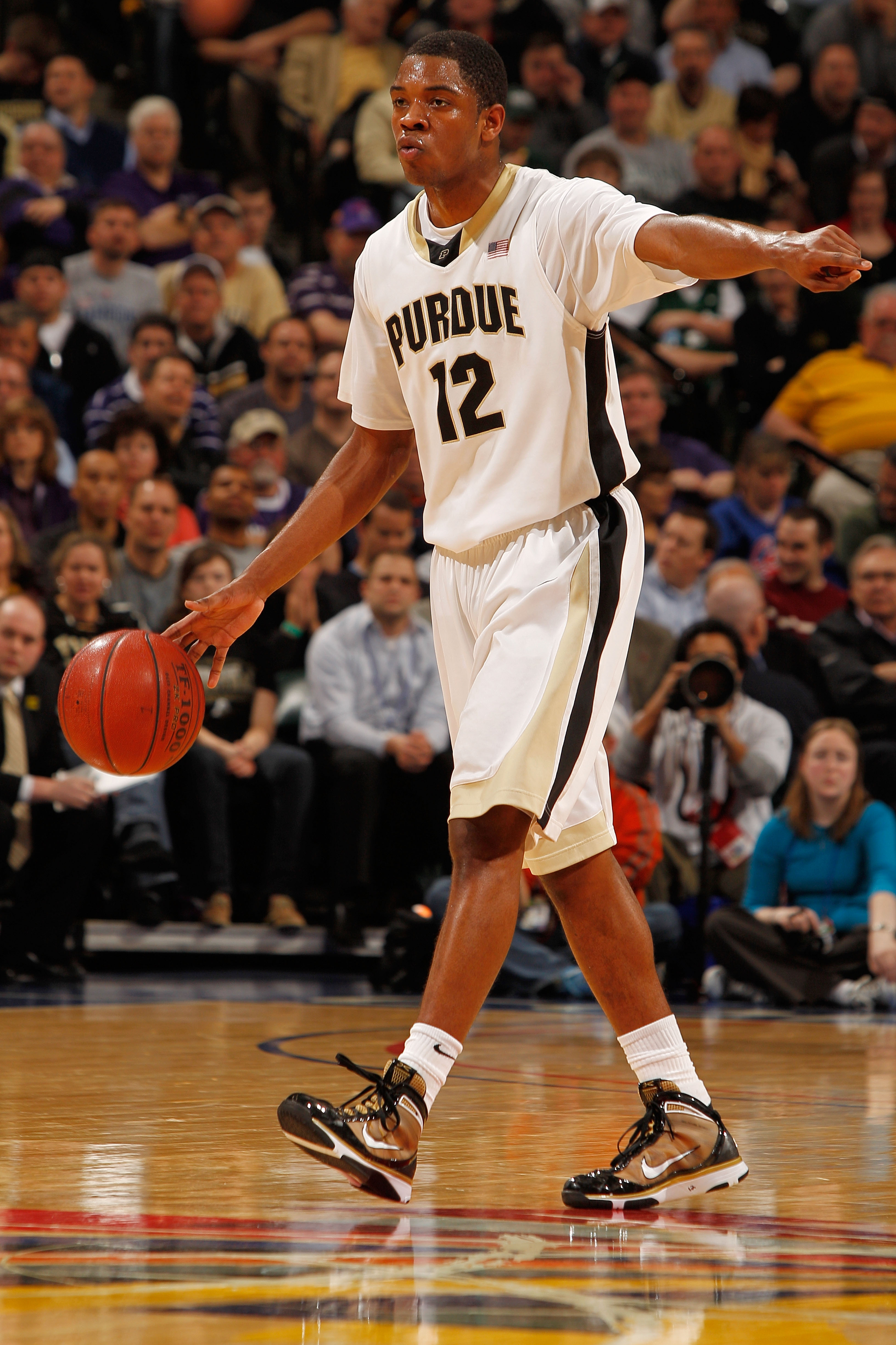 INDIANAPOLIS - MARCH 12:  Kelsey Barlow #12 of the Purdue Boilermakers dribbles the ball against the Northwestern Wildcats during the quarterfinals of the Big Ten Men's Basketball Tournament at Conseco Fieldhouse on March 12, 2010 in Indianapolis, Indiana