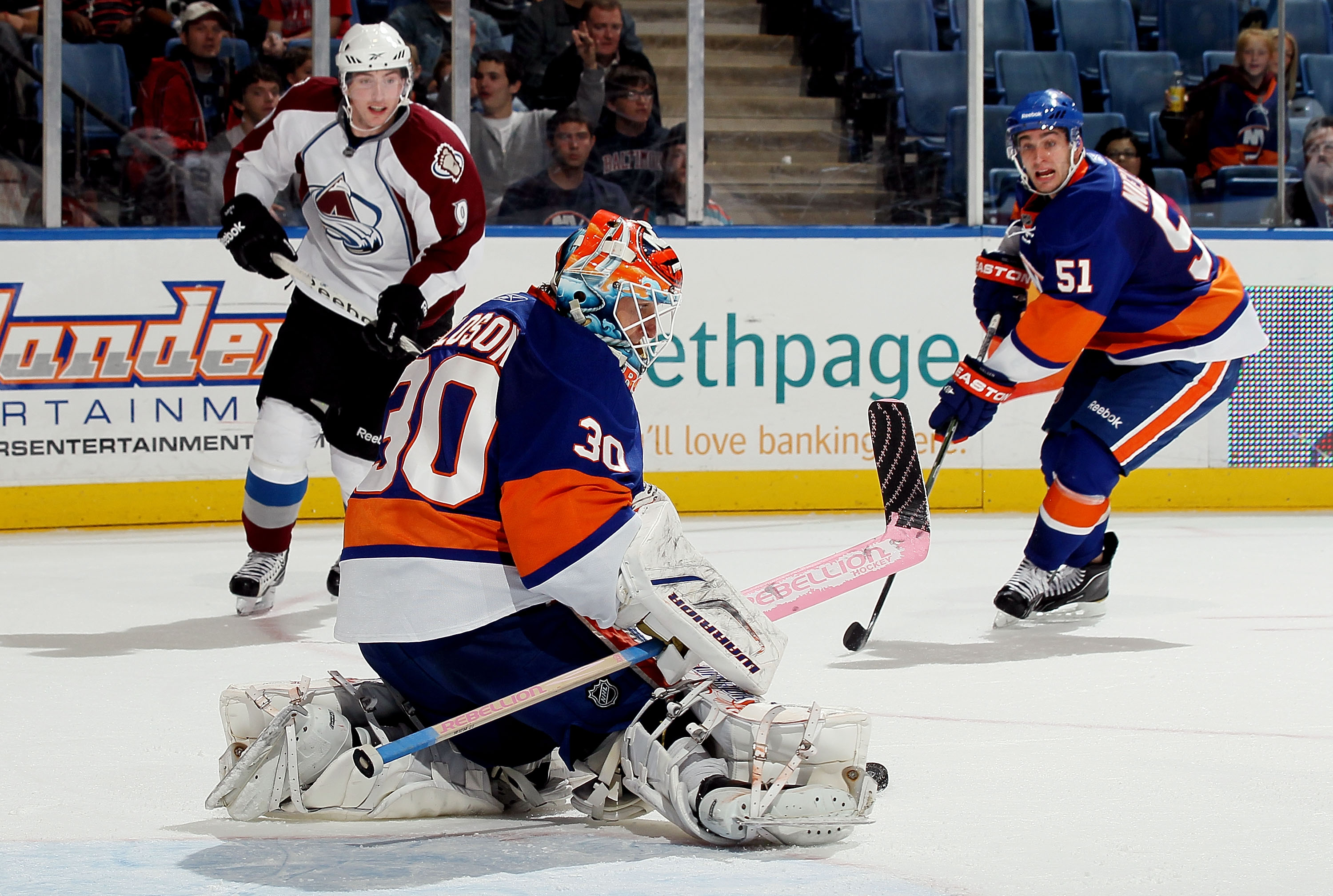 UNIONDALE, NY - OCTOBER 16:  Dwayne Roloson #30 of the New York Islanders makes a save against the Colorado Avalanche on October 16, 2010 at Nassau Coliseum in Uniondale, New York. The Isles defeated the Avalanche 5-2.  (Photo by Jim McIsaac/Getty Images)