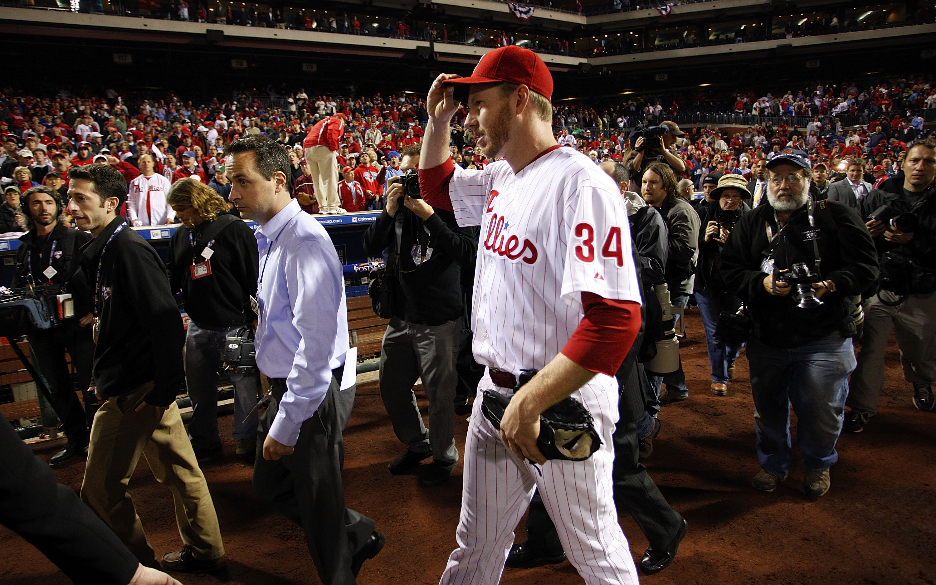 PHILADELPHIA - OCTOBER 06:  Roy Halladay #34 of the Philadelphia Phillies walks to the dugout after pitching a no-hitter in Game 1 of the NLDS against the Cincinnati Reds at Citizens Bank Park on October 6, 2010 in Philadelphia, Pennsylvania.  (Photo by J