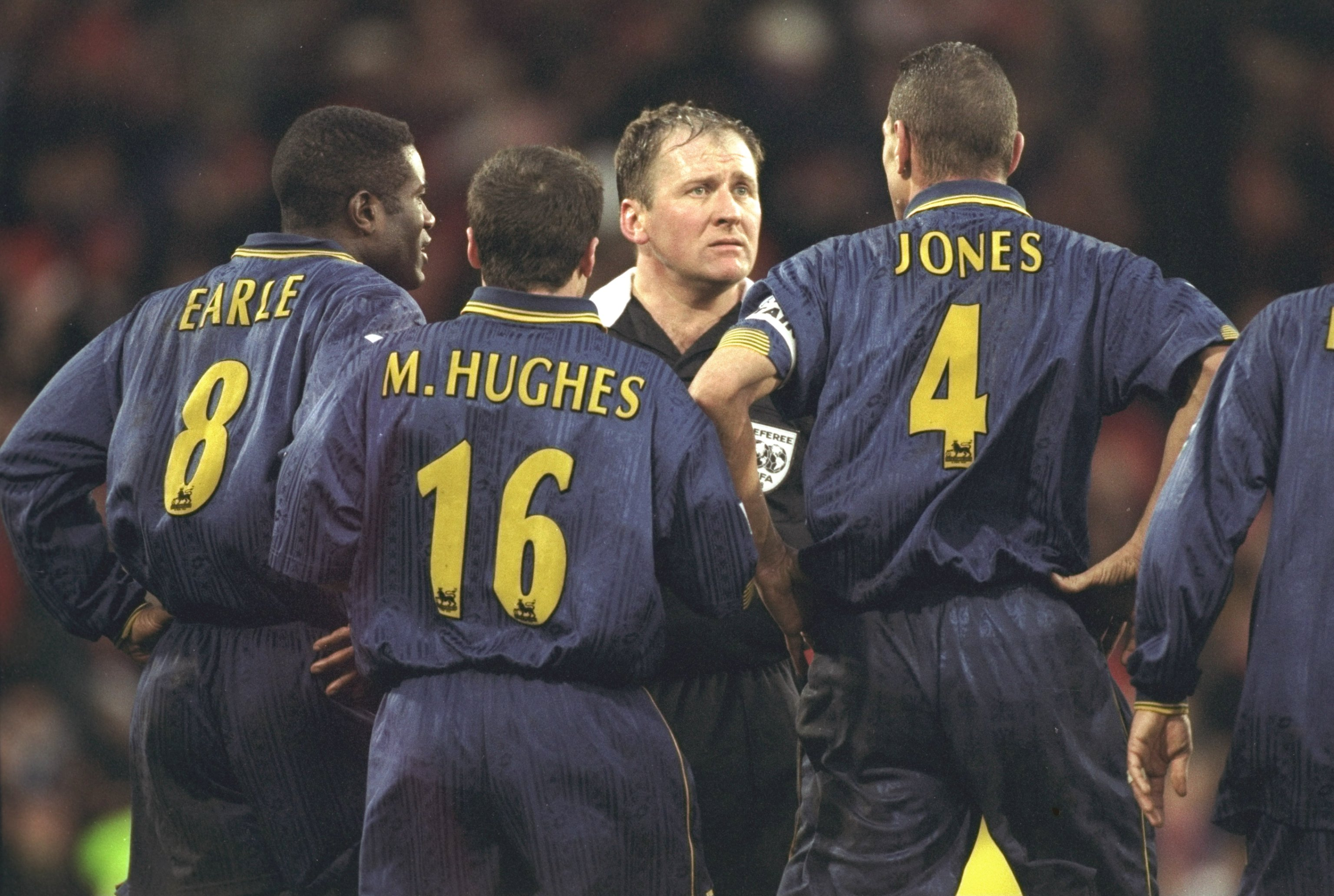 4 Jan 1998:  (left to right) Robbie Earle, Michael Hughes and Vinny Jones of Wimbledon confront the referee, Steve Dunn, after having a goal disallowed due to the whistle going for full time during the FA Cup third round tie against Wrexham at Selhurst Pa