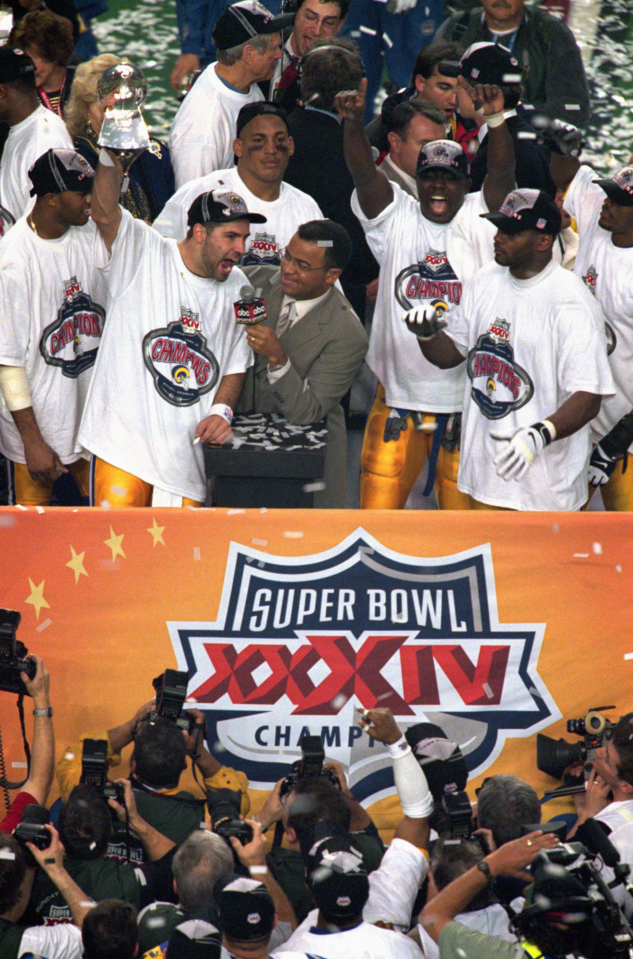 ATLANTA - JANUARY 30:  Quarterback Kurt Warner #13 of the St. Louis Rams celebrates as he hoist up the Lombardi trophy after defeating the Tennessee Titans 23-16 in Super Bowl XXXIV at the Georgia Dome on January 30, 2000 in Atlanta, Georgia.  (Photo by B