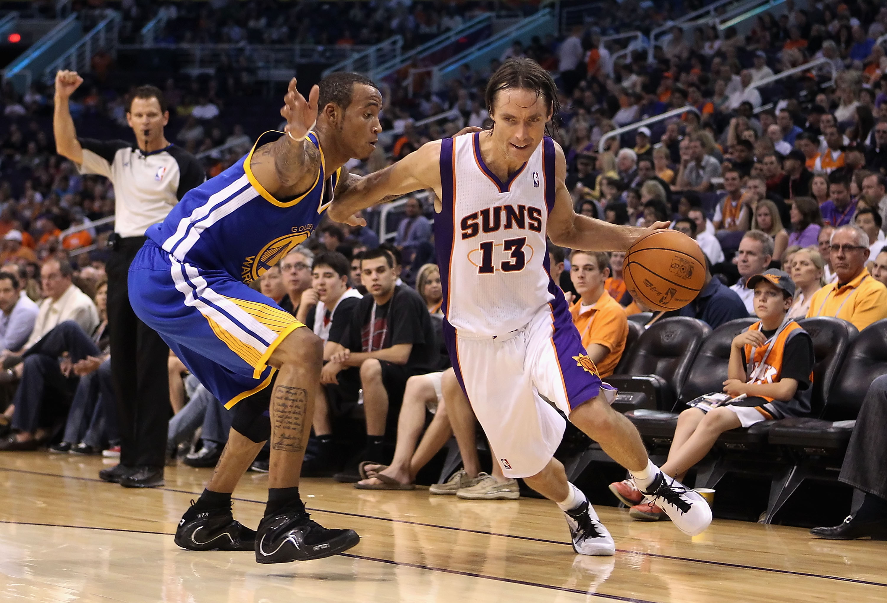 PHOENIX - OCTOBER 19:  Steve Nash #13 of the Phoenix Suns drives the ball past Monta Ellis #8 of the Golden State Warriors during the preseason NBA game at US Airways Center on October 19, 2010 in Phoenix, Arizona. NOTE TO USER: User expressly acknowledge