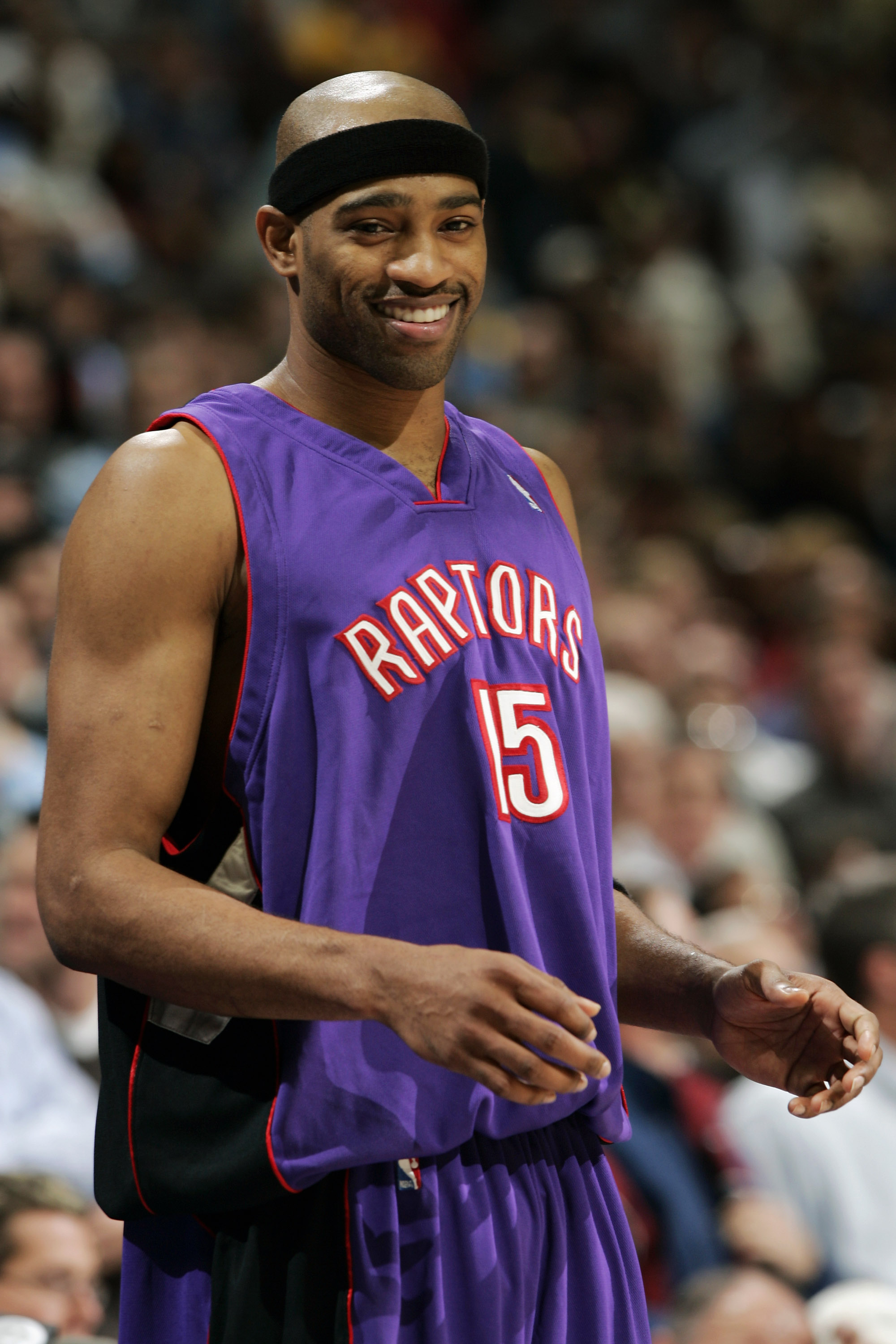 DENVER - NOVEMBER 17:  Vince Carter #15 of the Toronto Raptors smiles as he prepares to inbound the ball with less than a minute left in the game against the Denver Nuggets during NBA action on November 17, 2004 at the Pepsi Center in Denver, Colorado.  T