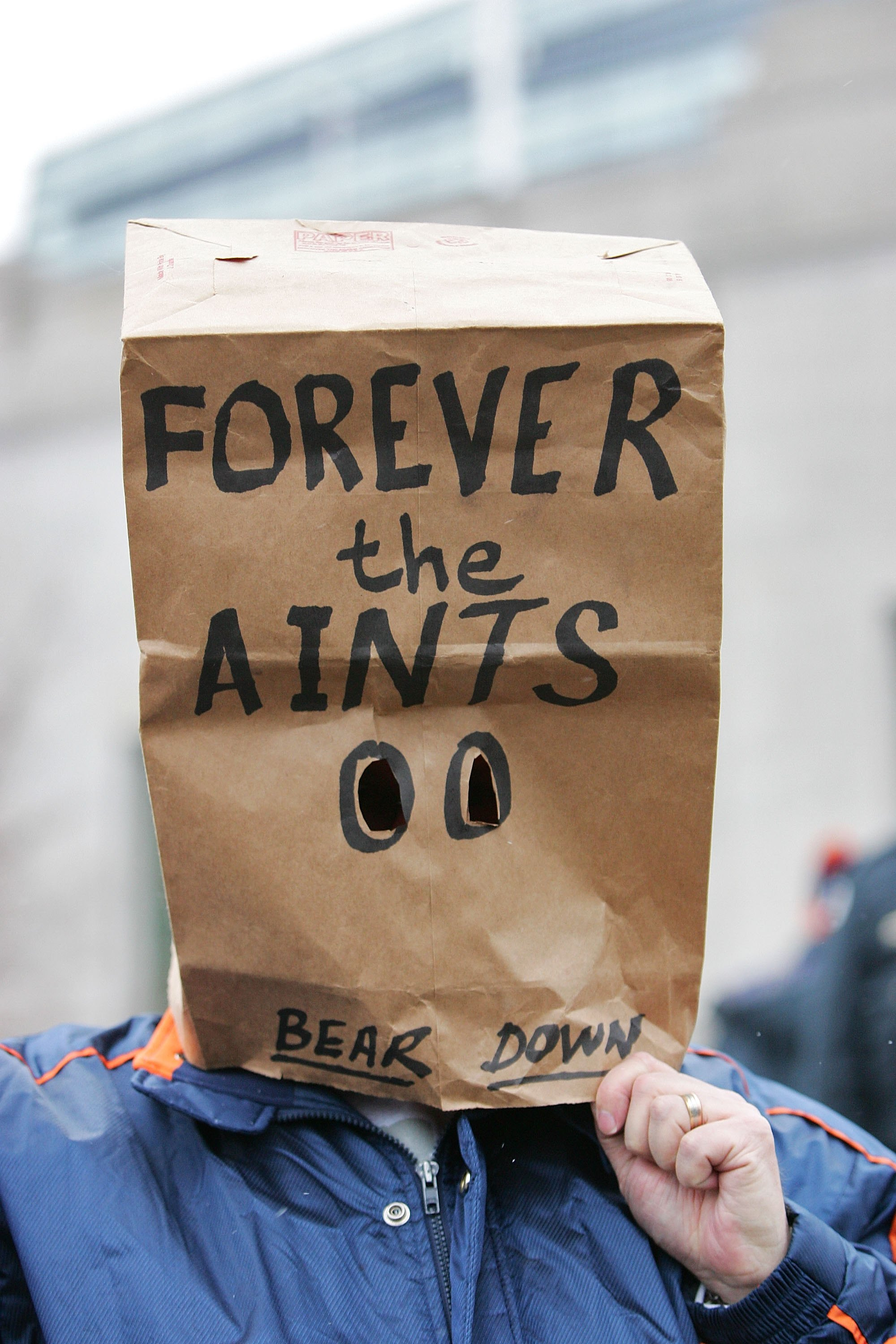 CHICAGO - JANUARY 21: A fan with a paper bag on his head with the words 'Forever the Aints Bear Down' on it stands outside before the NFC Championship Game between the New Orleans Saints and the Chicago Bears on January 21, 2007 at Soldier Field in Chicag