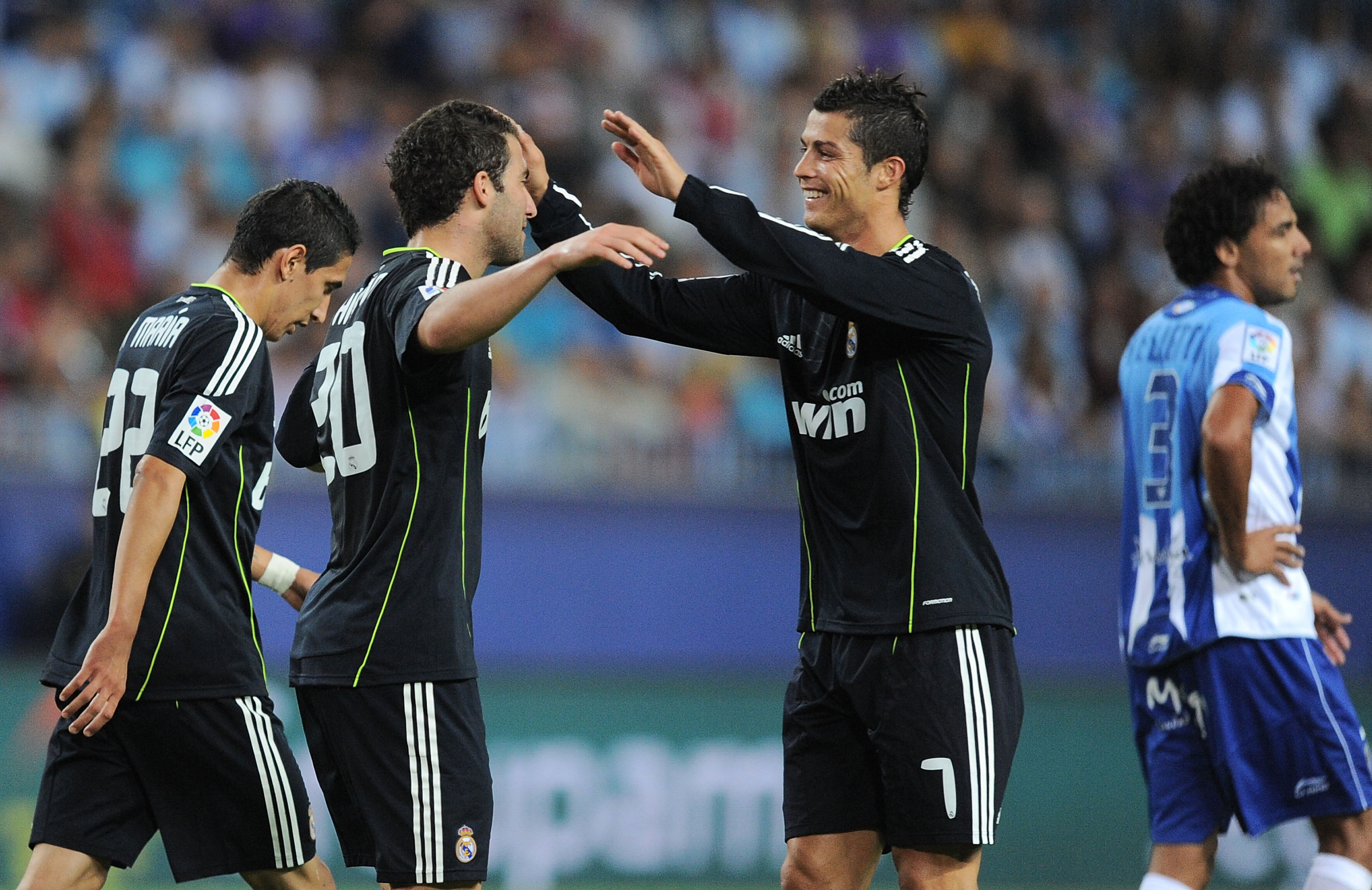 MALAGA, SPAIN - OCTOBER 16:  Cristiano Ronaldo (R) of Real Madrid celebrates with Gonzalo Higuain after Higuain scored Real's first goal during the La Liga match between Malaga and Real Madrid at La Rosaleda Stadium on October 16, 2010 in Malaga, Spain.