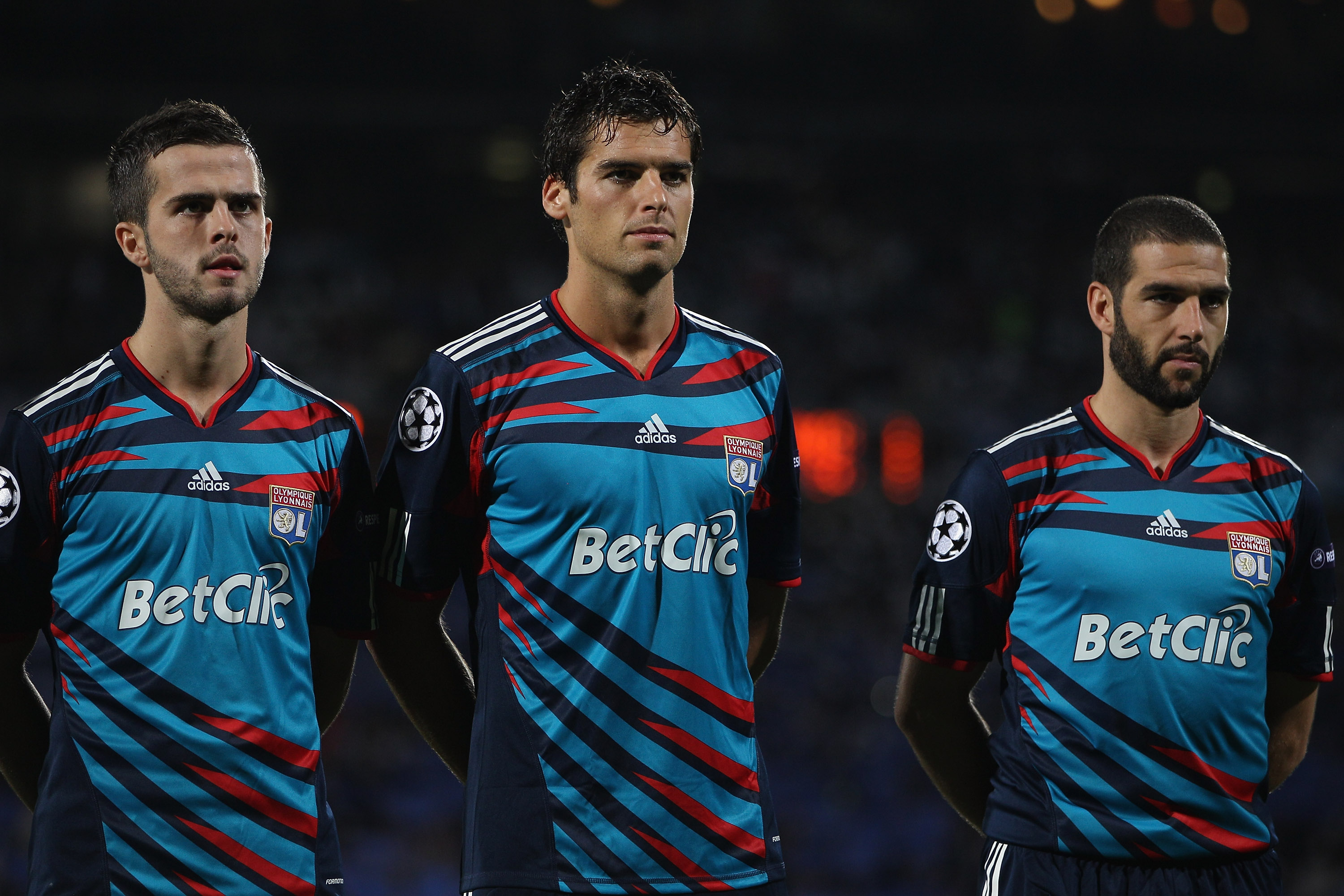 LYON, FRANCE - SEPTEMBER 14:  Miralem Pjanic (l),Yoann Gourcuff (c) and Lisandro (r) of Lyon line up before the UEFA Champions League Group B match between Olympique Lyonnais and FC Schalke 04 at the Stade de Gerland on September 14, 2010 in Lyon, France.