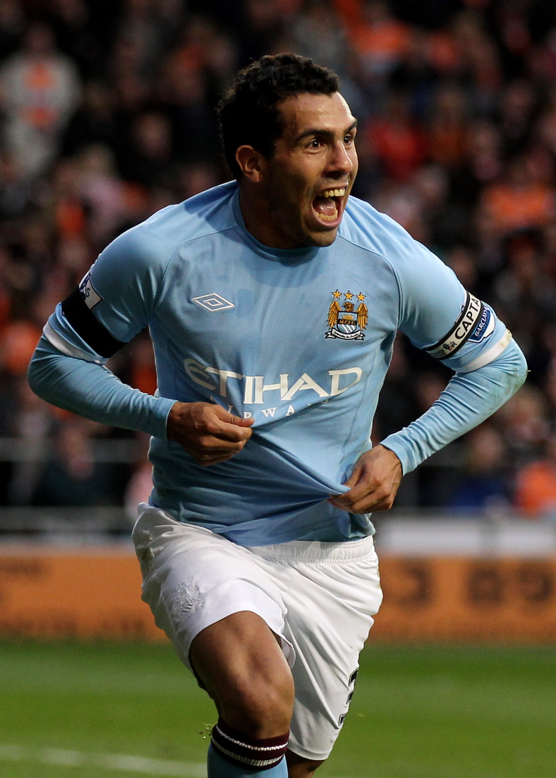 BLACKPOOL, ENGLAND - OCTOBER 17:  Carlos Tevez of Manchester City celebrates scoring the opening goal during the Barclays Premiership match between Blackpool and Manchester City at Bloomfield Road on October 17, 2010 in Blackpool, England.  (Photo by Alex