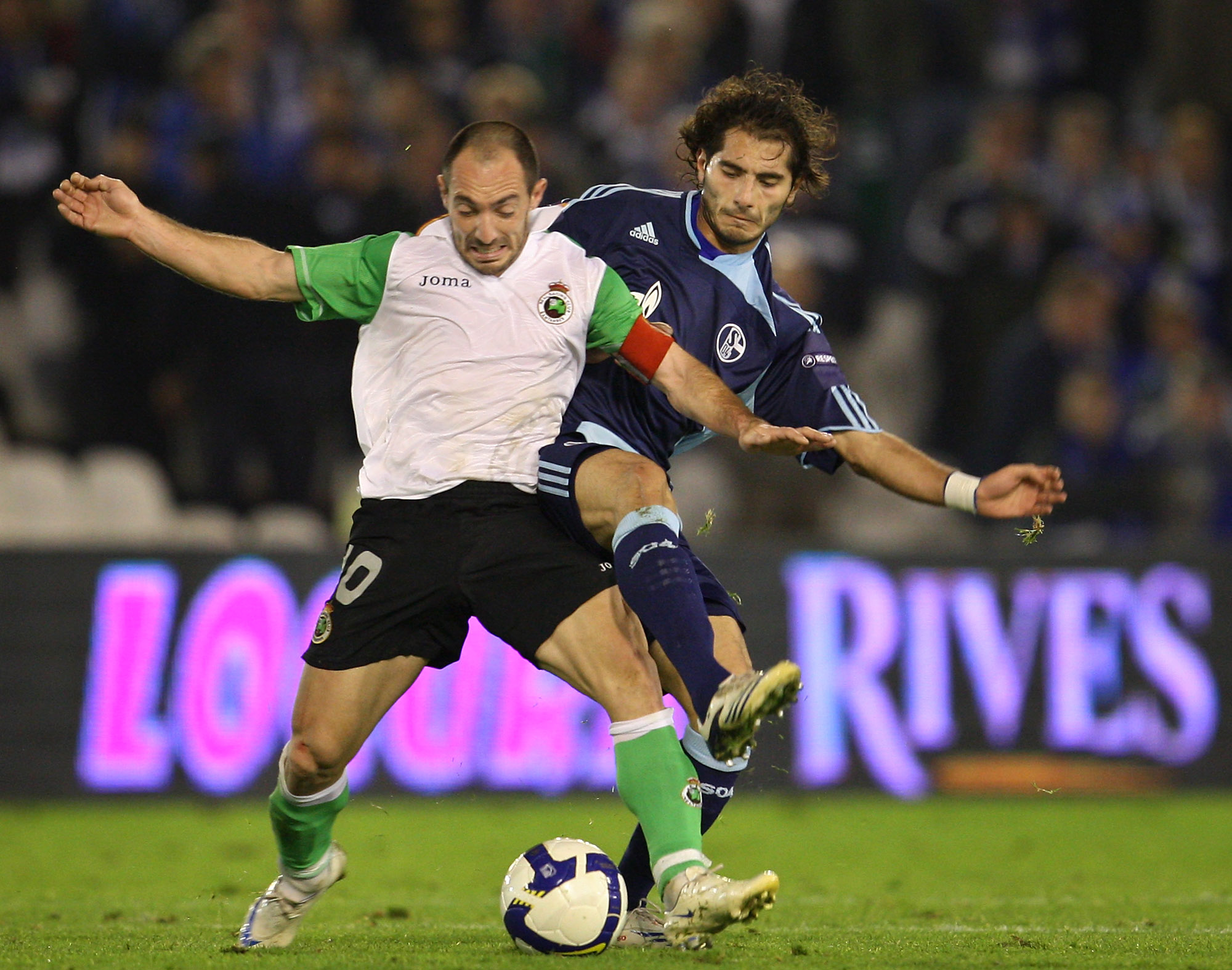 SANTANDER, SPAIN - NOVEMBER 06:  Halil Altintop (R) of Schalke 04 duels for the ball with Pedro Munitis of Racing Santander during the UEFA Cup group A match between Racing Santander and Schalke 04 at the El Sardinero stadium on November 6, 2008 in Santan