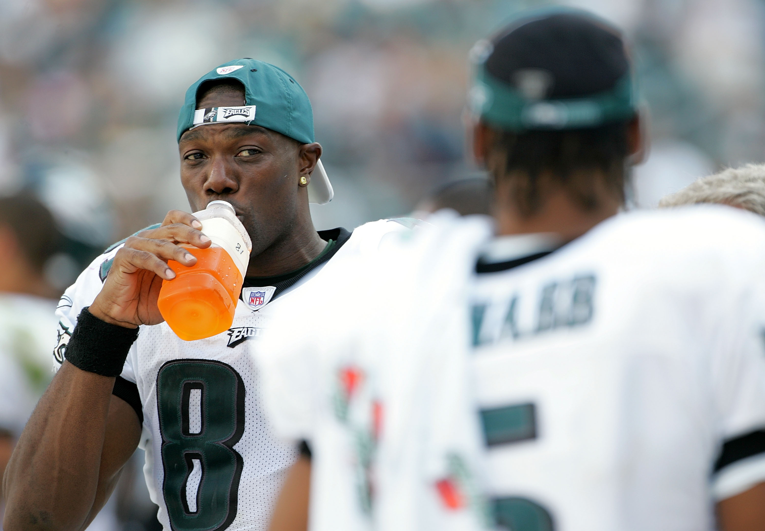 PHILADELPHIA - SEPTEMBER 18:  Receiver Terrell Owens #81 speaks with quarterback Donovan McNabb #5 of the Philadelphia Eagles while on the sidelines during the second half of the game against the San Francisco 49ers on September 18, 2005 at Lincoln Financ