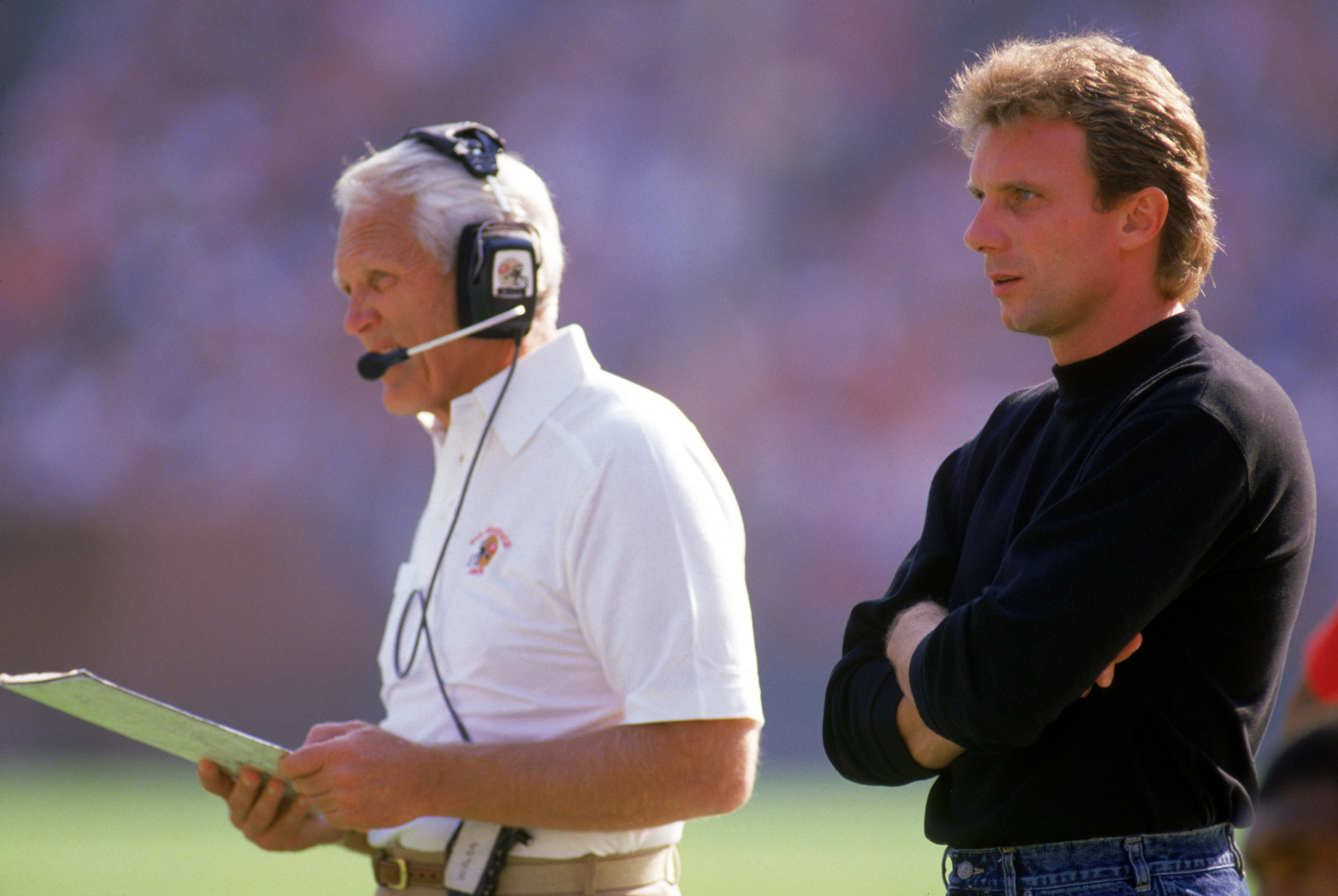 SAN FRANCISCO - OCTOBER 30: Head coach Bill Walsh and injured quarterback Joe Montana #16 of the San Francisco 49ers looks on from the sideline during a game against the Minnesota Vikings at Candlestick Park on October 30, 1988 in San Francisco, Californi