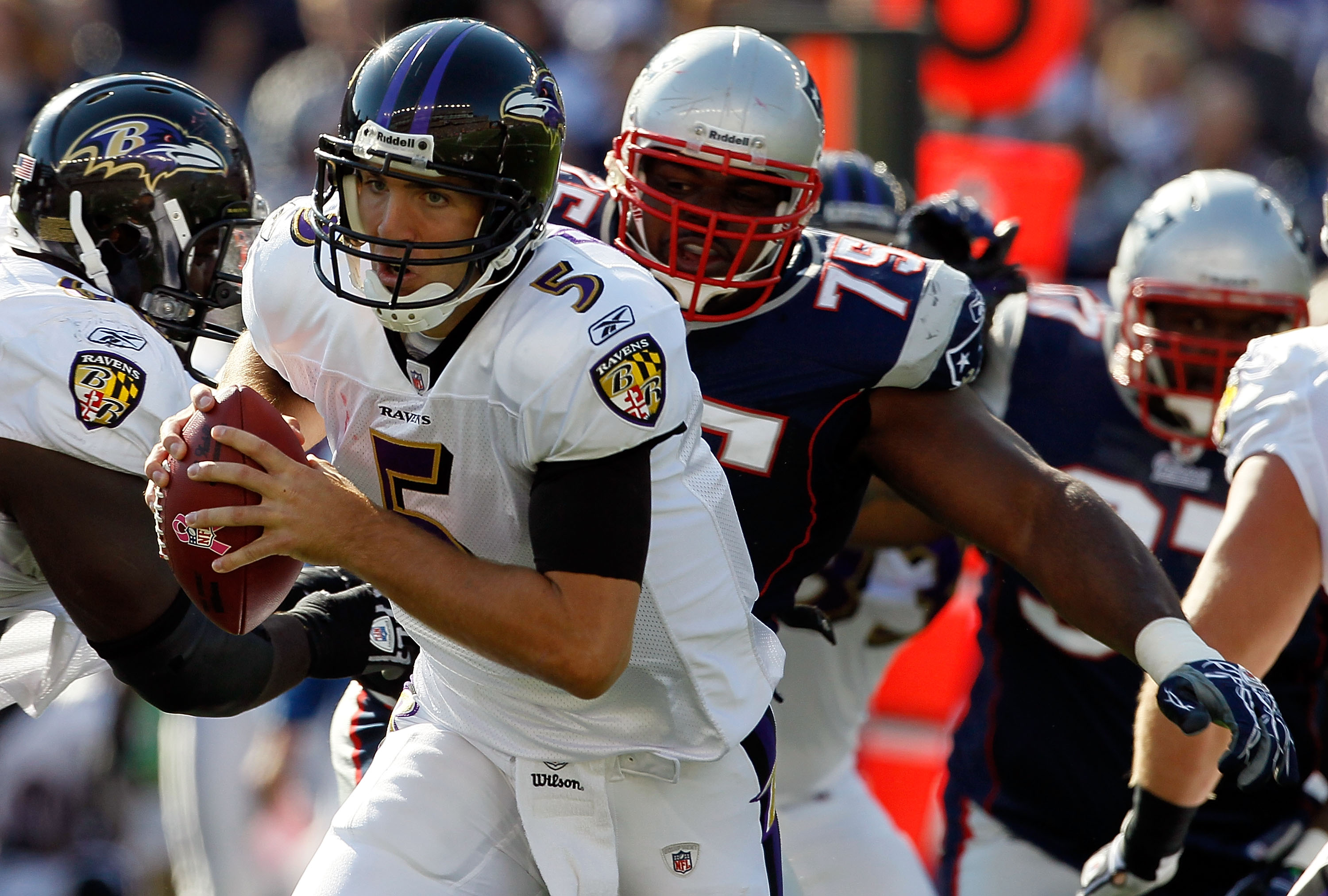 FOXBORO, MA - OCTOBER 17:  Vince Wilfork #75 of the New England Patriots chases Joe Flacco #5 of the Baltimore Ravens in the first half at Gillette Stadium on October 17, 2010 in Foxboro, Massachusetts. The Patriot won 23-20 in overtime.  (Photo by Jim Ro