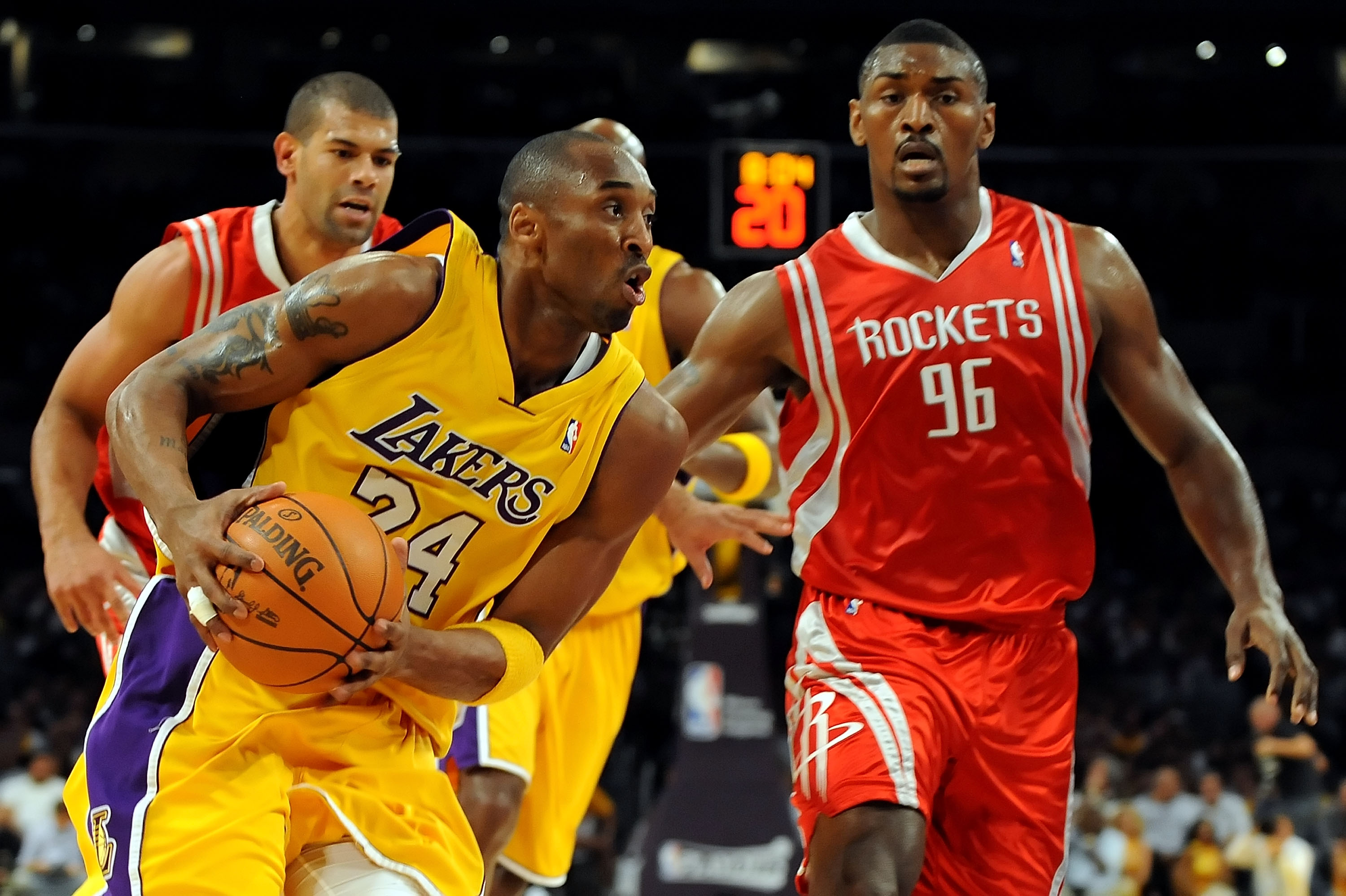 LOS ANGELES, CA - MAY 06:  Kobe Bryant #24 of the Los Angeles Lakers drives between (R) Ron Artest #96 and Shane Battier #31 of the Houston Rockets in the first half of Game Two of the Western Conference Semifinals during the 2009 NBA Playoffs at Staples