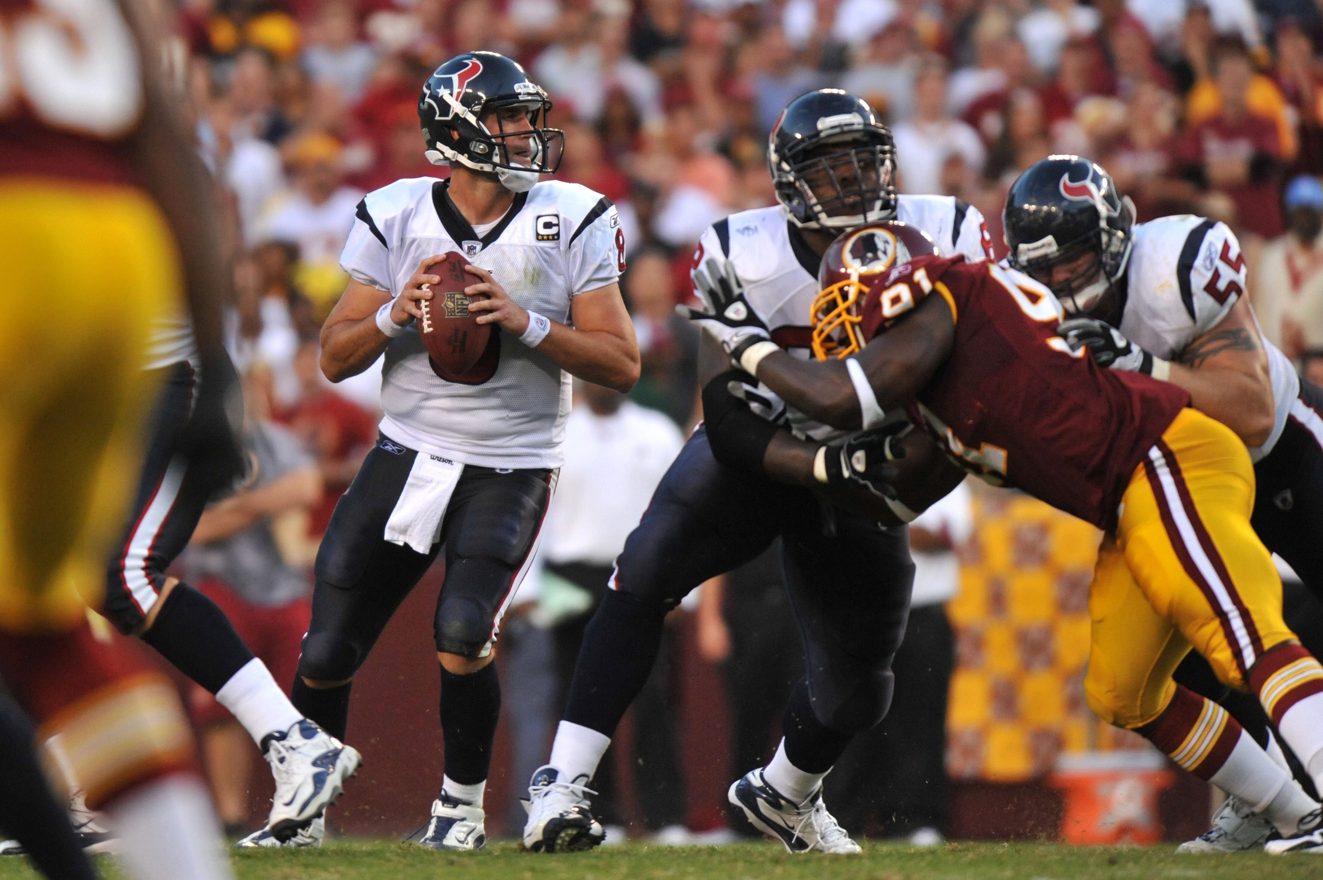 LANDOVER - SEPTEMBER 19:  Matt Schaub # of the Houston Texans looks for a receiver during the game against the Washington Redskins at FedExField on September 19, 2010 in Landover, Maryland. The Texans defeated the Redskins 30-27 in overtime. (Photo by Lar