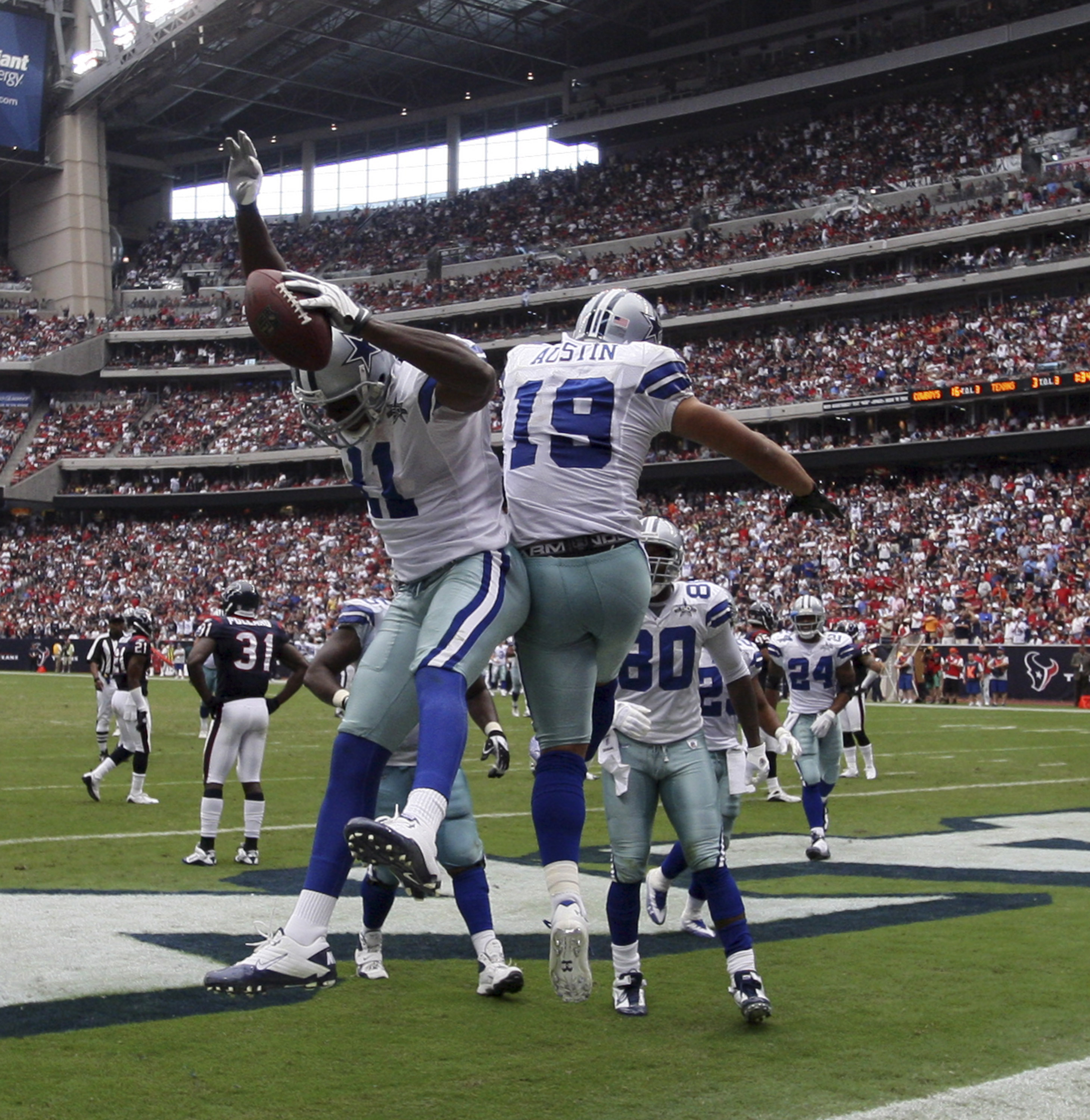 HOUSTON - SEPTEMBER 26:  Wide receiver Roy Williams #11 and Miles Austin #11 celebrate after scoring on a 15 yard pass from Tony Romo in the third quarter at Reliant Stadium on September 26, 2010 in Houston, Texas.  (Photo by Bob Levey/Getty Images)