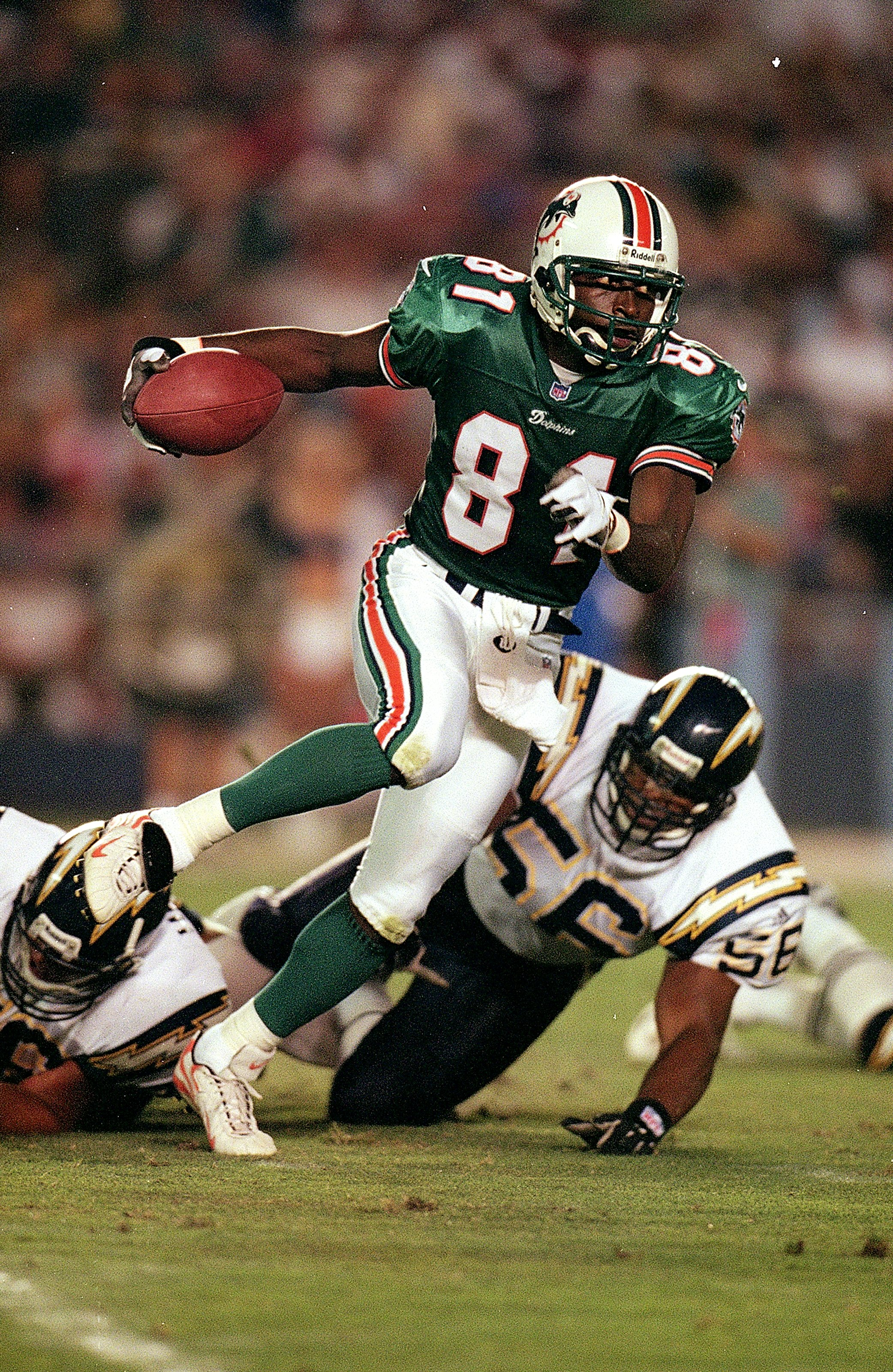 21 Aug 1999:  O.J. McDuffie #81 of the Miami Dolphins carries the ball during the game against the San Diego Chargers at the Qualcomm Stadium in San Diego, California. The Dolphins defeated the Chargers 13-10. Mandatory Credit: Tom Hauck/Allsport
