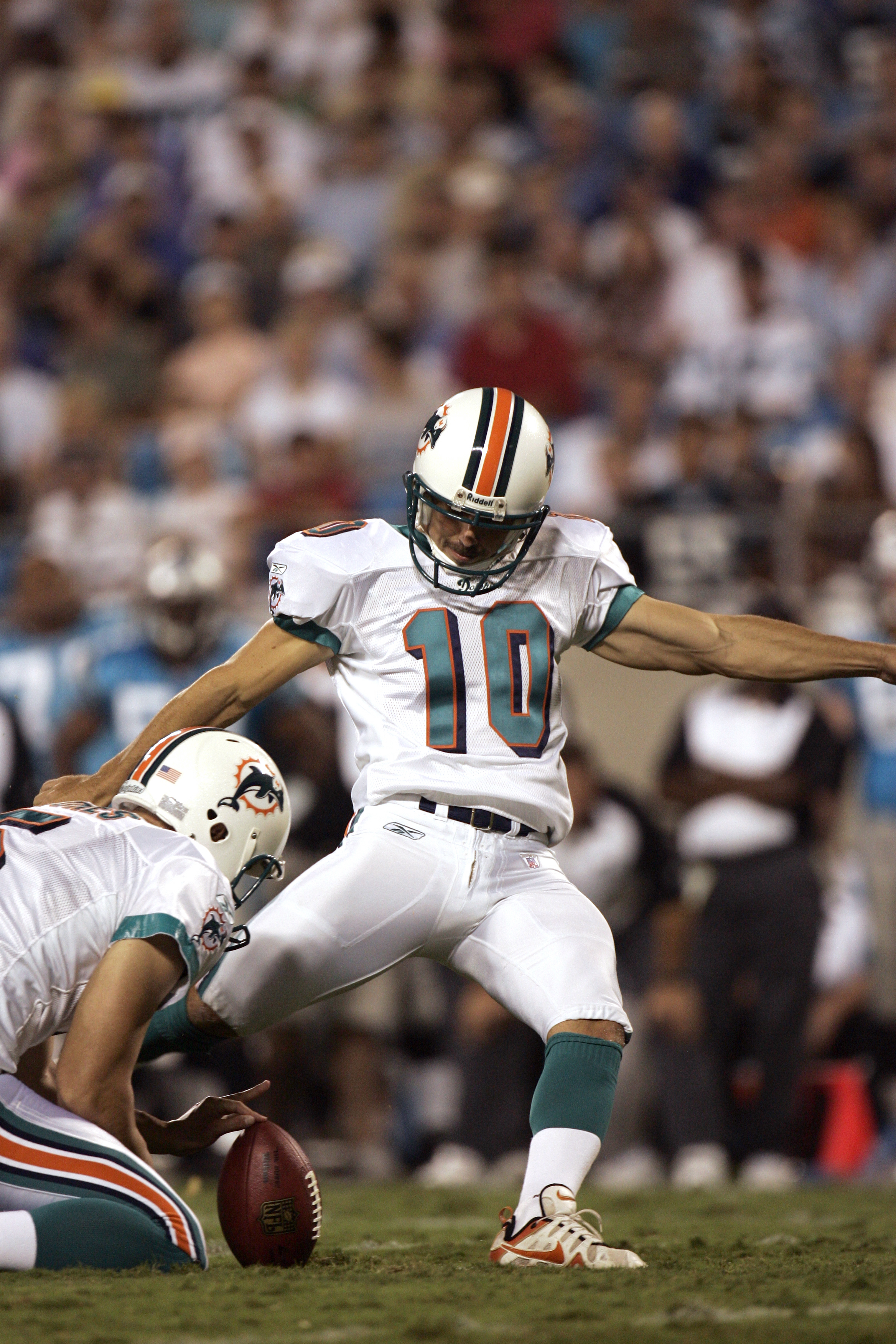 CHARLOTTE, NC - AUGUST 24:  Kicker Olindo Mare #10 of the Miami Dolphins attempts to score, as punter Donnie Jones #5 holds the ball, during the preseason game against the Carolina Panthers at Bank of America Stadium in Charlotte, North Carolina, on Augus