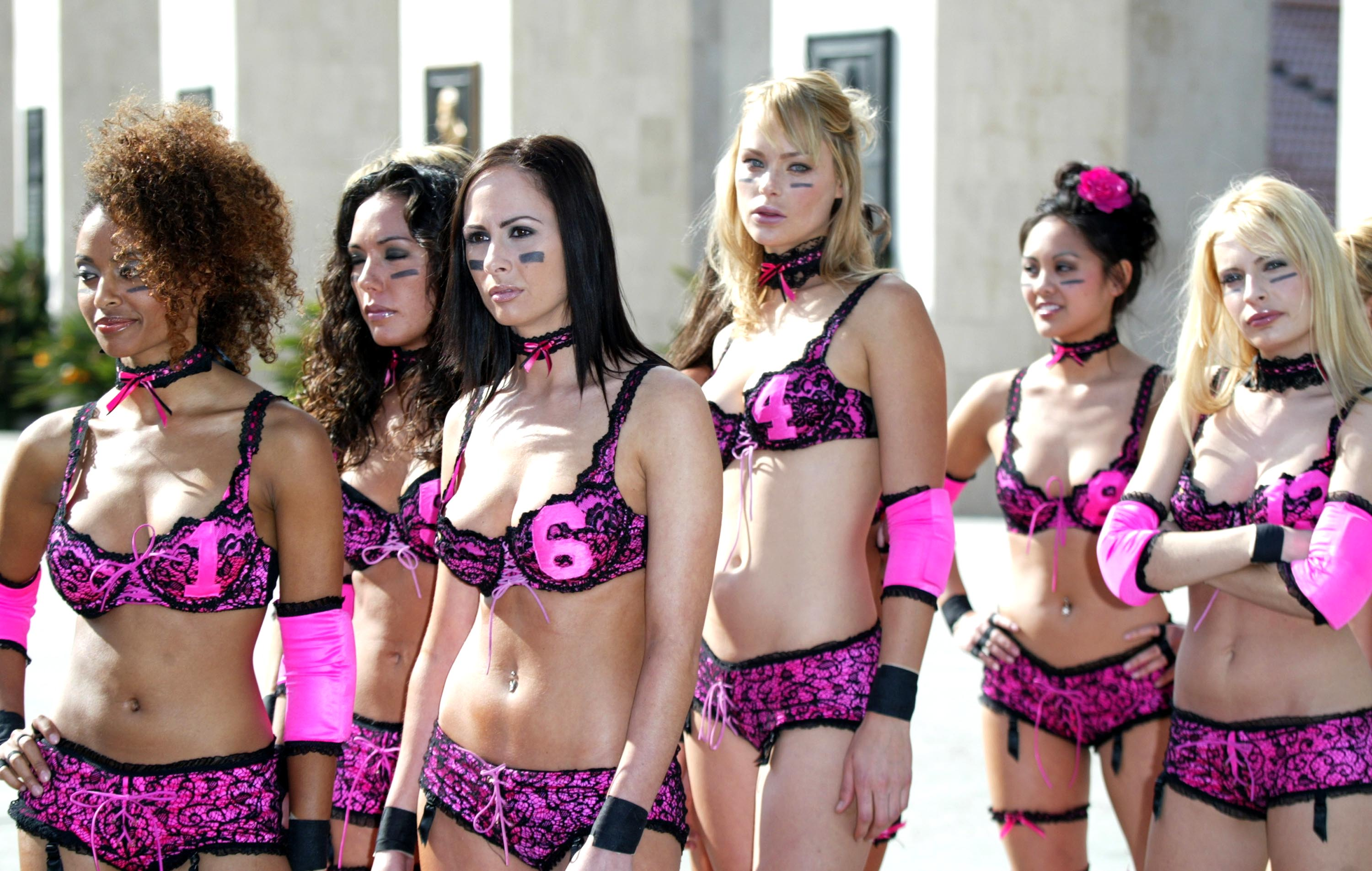 LOS ANGELES- JANUARY 26:  Team Euphoria arrive for  a news conference for the 2004 Lingerie Bowl at the Los Angeles Coliseum, on January 26, 2004 in Los Angeles, California.  (Photo by Frazer Harrison/Getty Images for Lingerie Bowl)