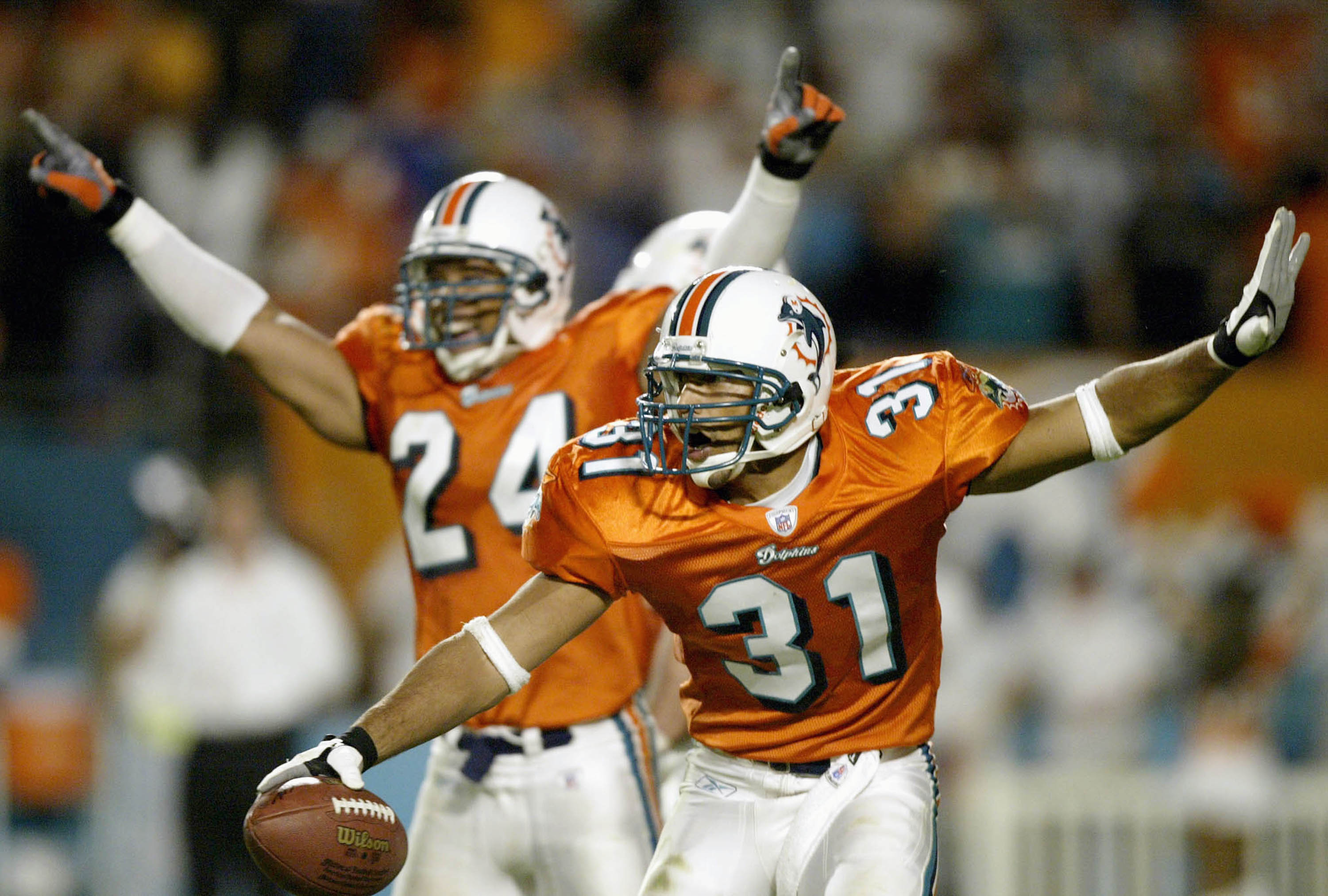 MIAMI - NOVEMBER 23:  Brock Marion #31 of the Miami Dolphins celebrates an interception against the Washington Redskins late in the fourth quarter November 23, 2003 at Pro Player Stadium in Miami, Florida. (Photo by Matthew Stockman/Getty Images)