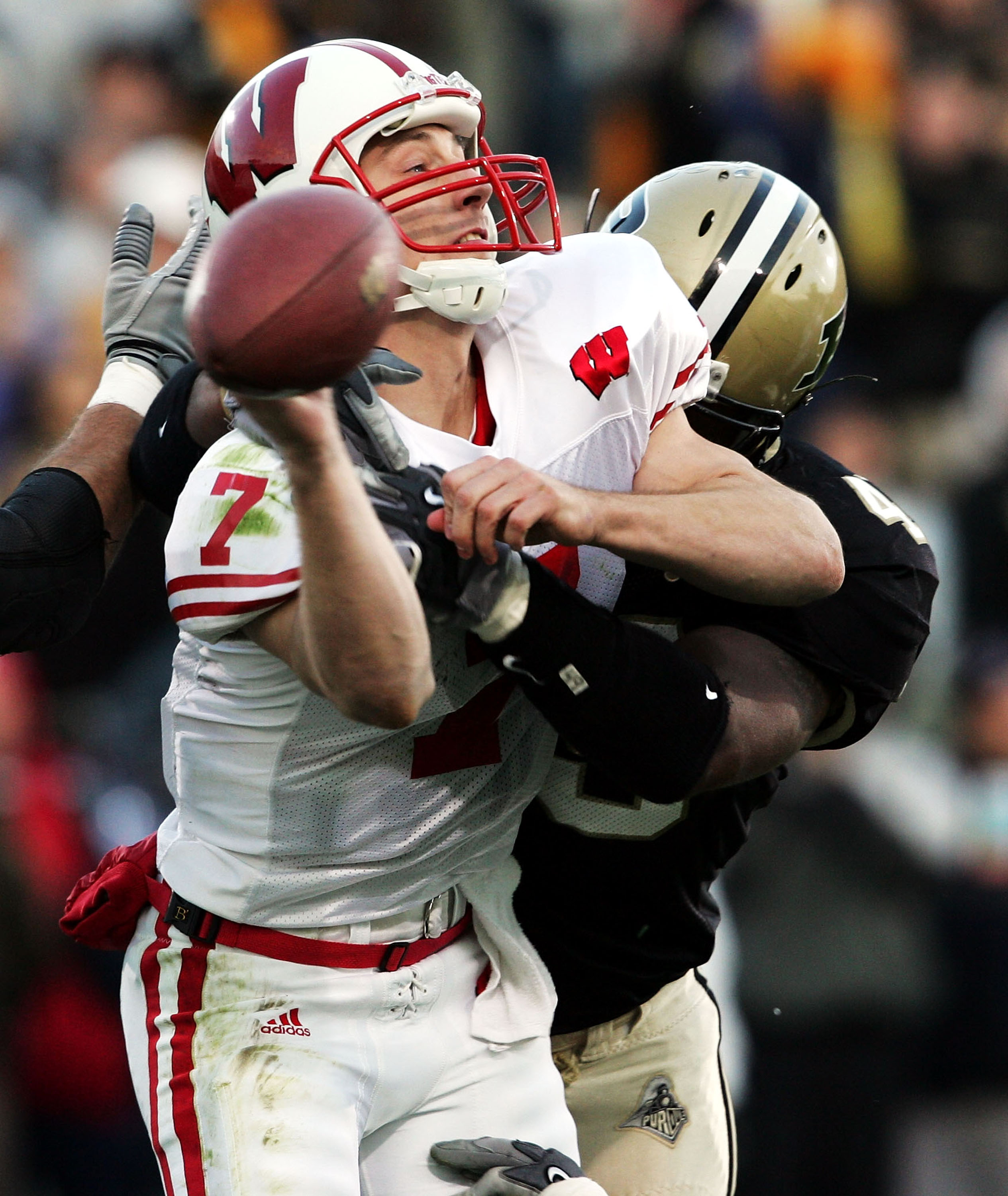 WEST LAYFAYETTE, IN - OCTOBER 16:  John Stocco #7 of Wisconsin throws the ball while being hit by Anthony Spencer #49 of Purdue  during the game at Ross-Ade Stadium on October 16, 2004 in West Lafayette, Indiana.    (Photo by Andy Lyons/Getty Images)