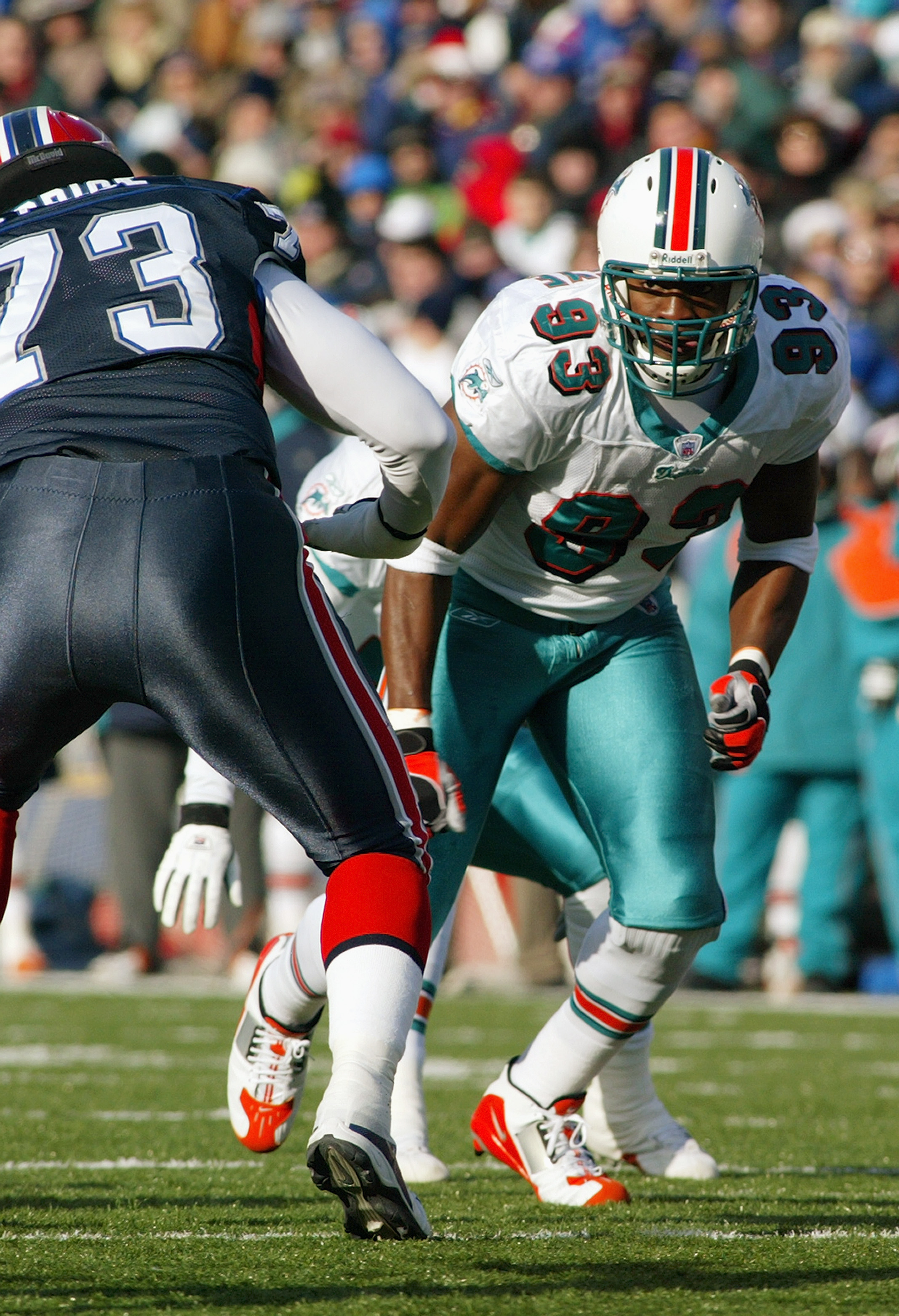ORCHARD PARK, NY - DECEMBER 21:  Defensive end Adewale Ogunleye #93 of the Miami Dolphins looks to avoid getting blocked by offensive tackle Marcus Price #73 of the Buffalo Bills during the game on December 21, 2003 at Ralph Wilson Stadium in Orchard Park