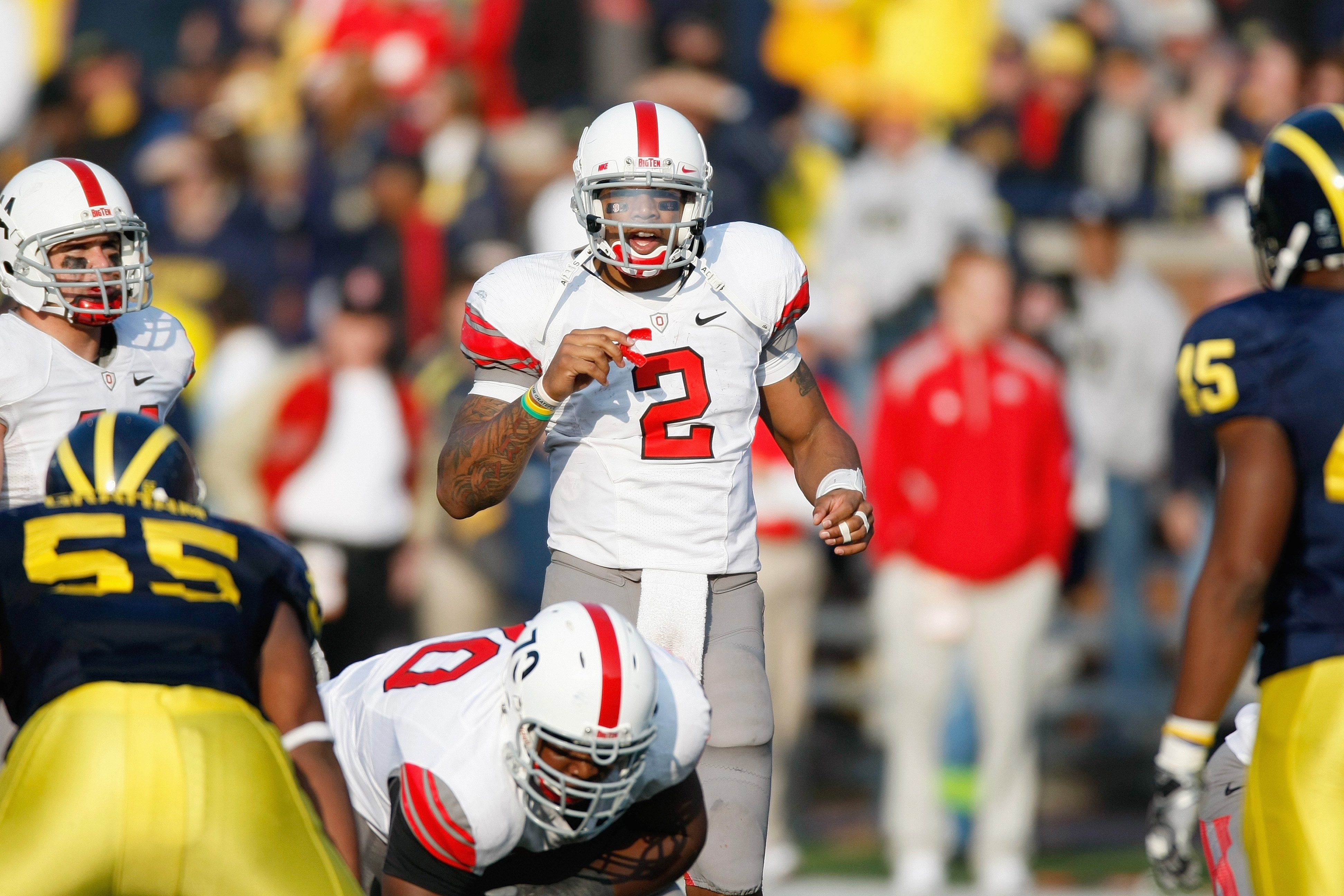 ANN ARBOR, MI - NOVEMBER 21: Quarterback Terrelle Pryor #2 of the Ohio State Buckeyes gets ready at the line of scrimmage during the game against the Michigan Wolverines on November 21, 2009 at Michigan Stadium in Ann Arbor, Michigan. Ohio State won the g