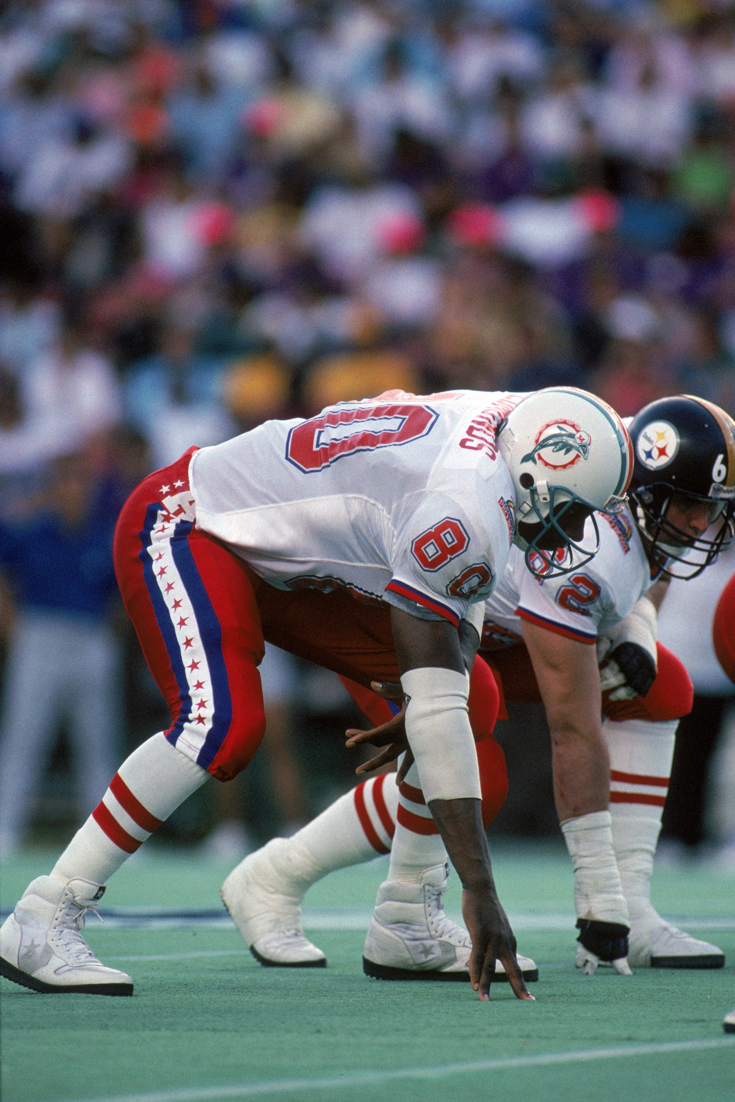 HONOLULU, HI - FEBRUARY 4:  Miami Dolphins tight end Ferrell Edmunds #80 of the AFC squad lines up at the line of scrimmage during the 1990 NFL Pro Bowl at Aloha Stadium on February 4, 1990 in Honolulu, Hawaii.  The NFC won 27-21.  (Photo by George Rose/G