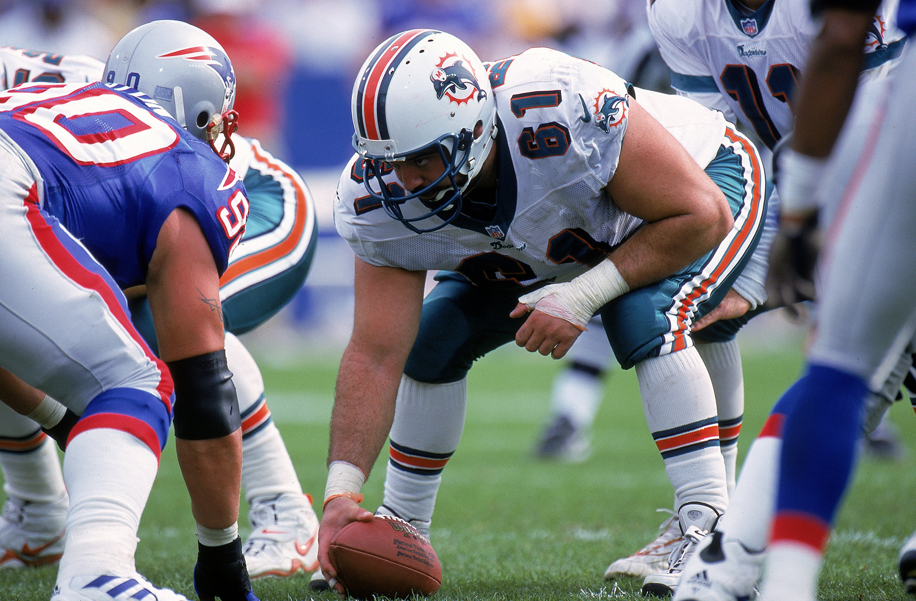 17 Oct 1999: Tim Ruddy #61 of the Miami Dolphins gets ready to hike the ball during the game against the New England Patriots at the Foxboro Stadium in Foxboro, Massachusetts. The Dolphins defeated the Patriots 31-30.
