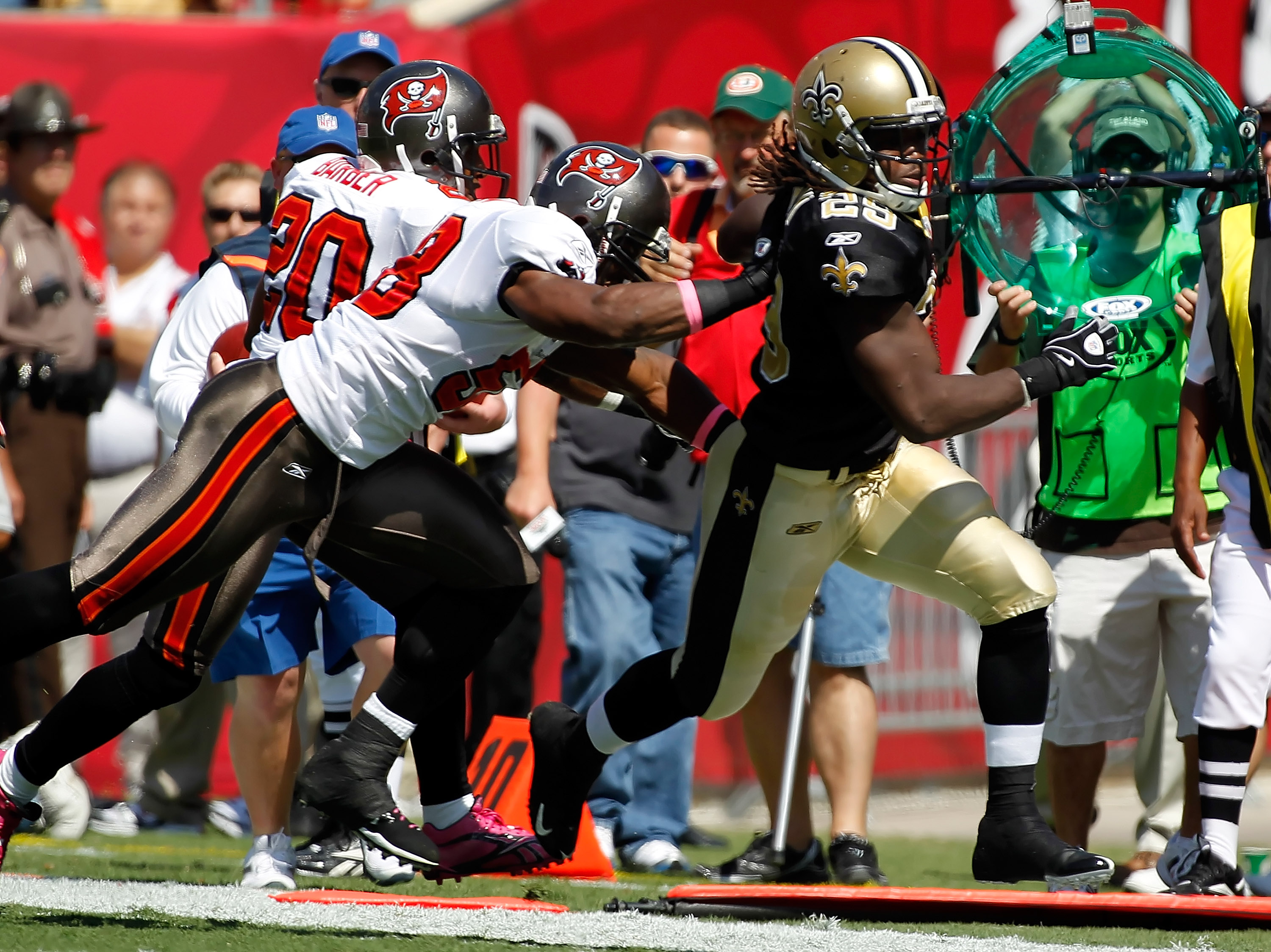TAMPA, FL - OCTOBER 17:  Running back Chris Ivory #29 of the New Orleans Saints is knocked out of bounds by linebacker Quincy Black #58 of the Tampa Bay Buccaneers during the game at Raymond James Stadium on October 17, 2010 in Tampa, Florida.  (Photo by