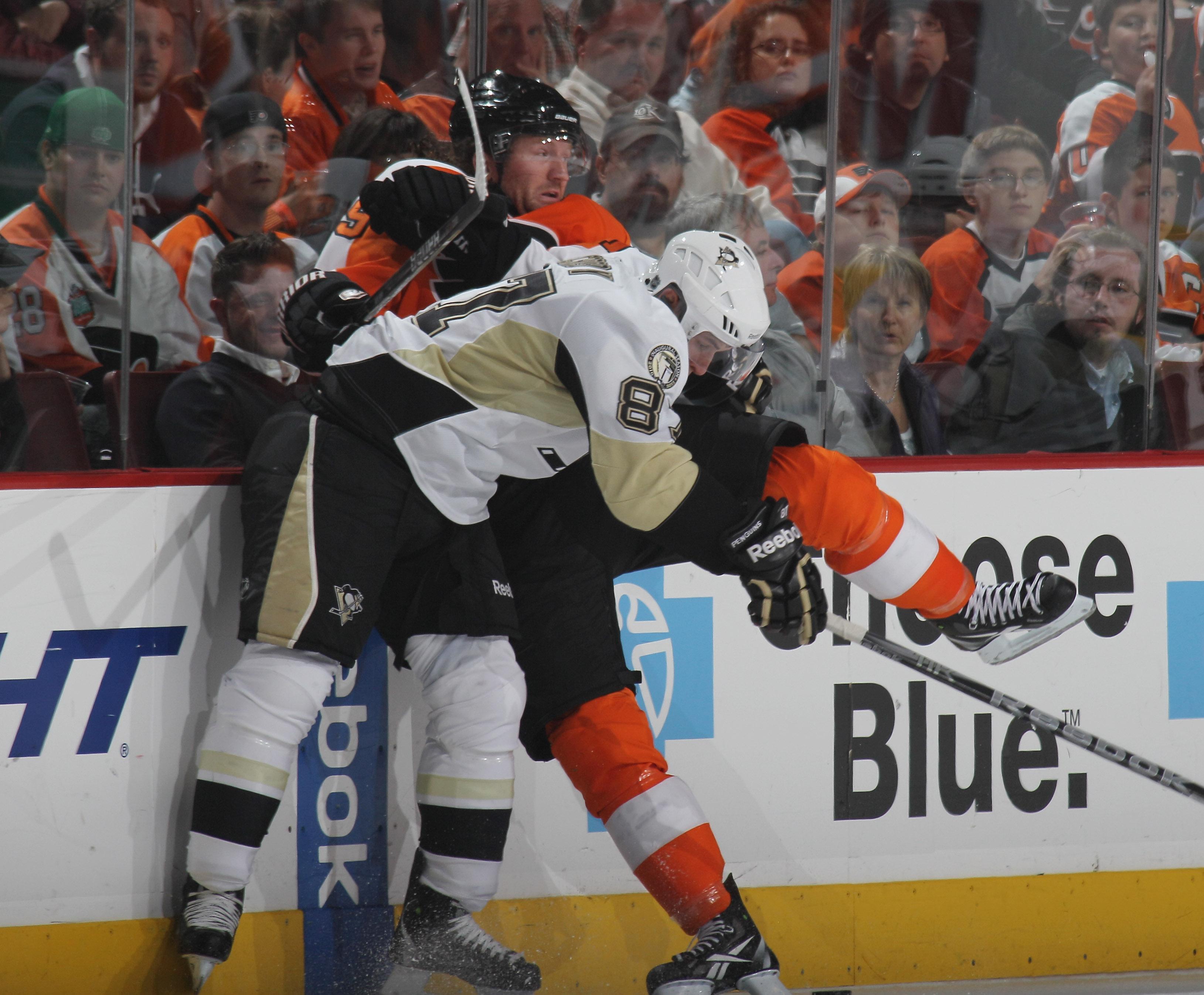 PHILADELPHIA - OCTOBER 16: Sidney Crosby #87 of the Pittsburgh Penguins hits Scott Hartnell #19 of the Philadelphia Flyers at the Wells Fargo Center on October 16, 2010 in Philadelphia, Pennsylvania.  (Photo by Bruce Bennett/Getty Images)