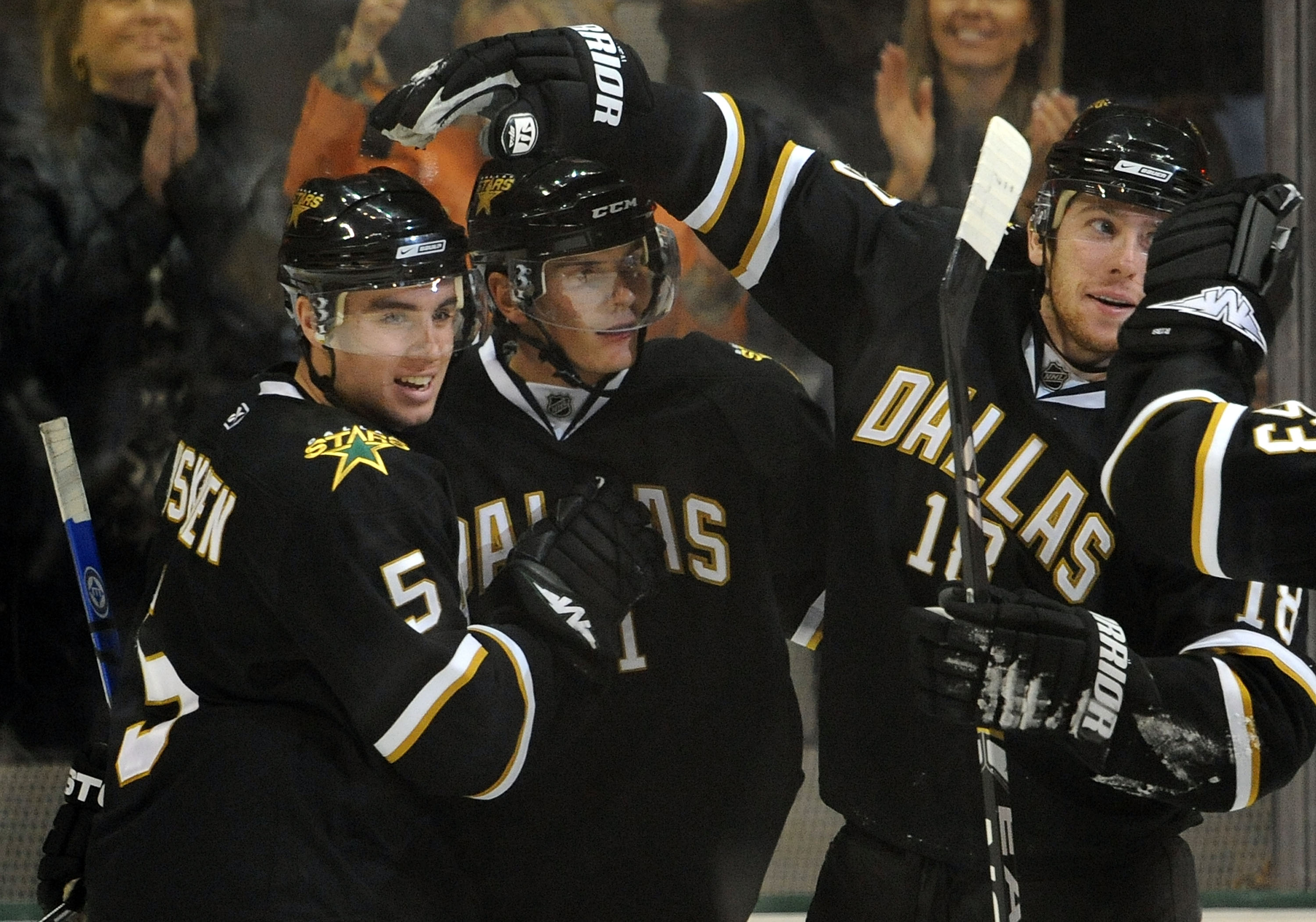 DALLAS - FEBRUARY 03:  (L-R) Matt Niskanen #5, Loui Eriksson #21 and James Neal #18 of the Dallas Stars celebrate a goal against the Calgary Flames in the second period at the American Airlines Center on February 3, 2009 in Dallas, Texas.  (Photo by Ronal
