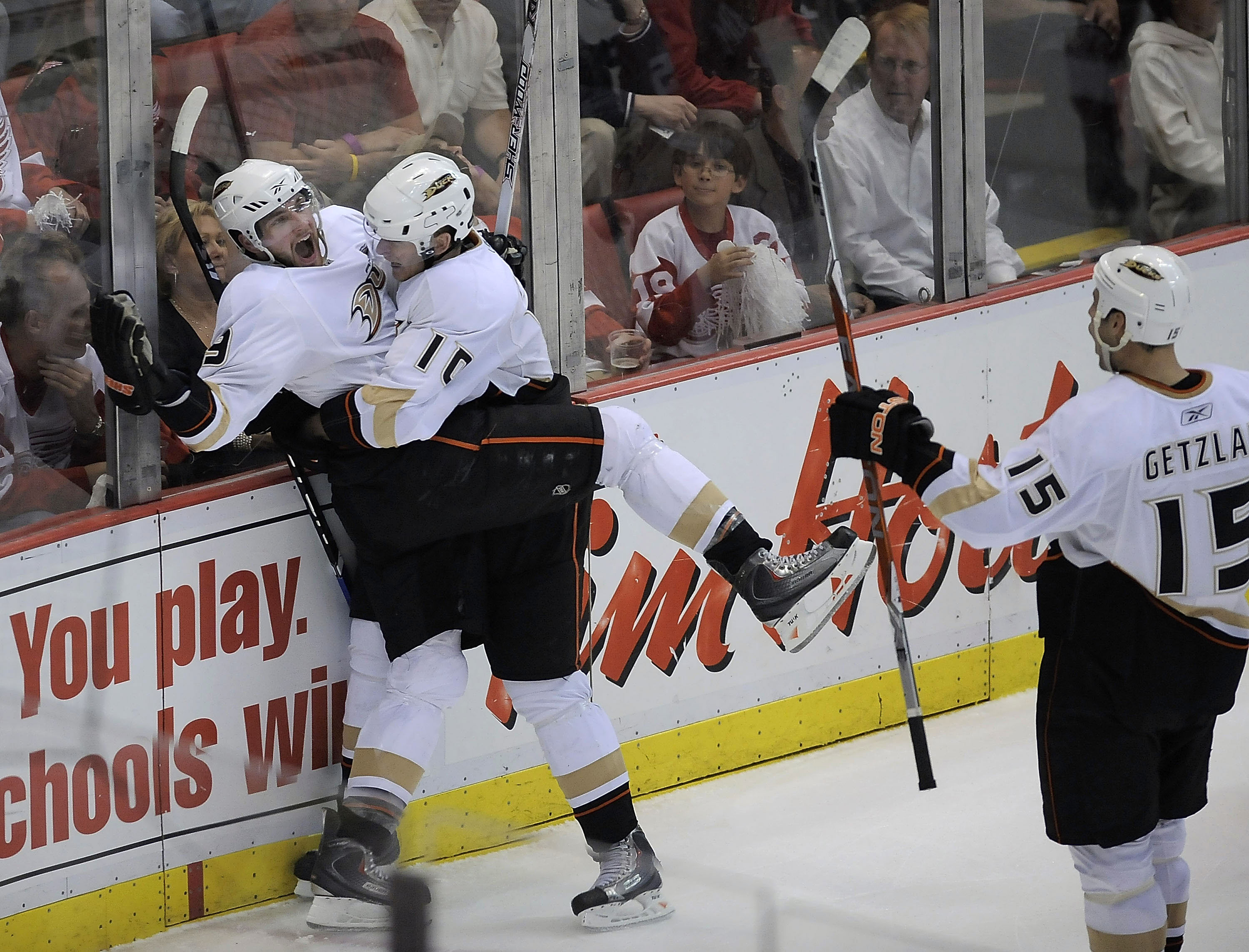 DETROIT - MAY 14: Bobby Ryan #9 of the Anaheim Ducks celebrates his third period goal with Corey Perry #10 and Ryan Getzlaf #15 while playing the Detroit Red Wings in Game Seven of the Western Conference Semifinals of the 2009 NHL Stanley Cup Playoffs on
