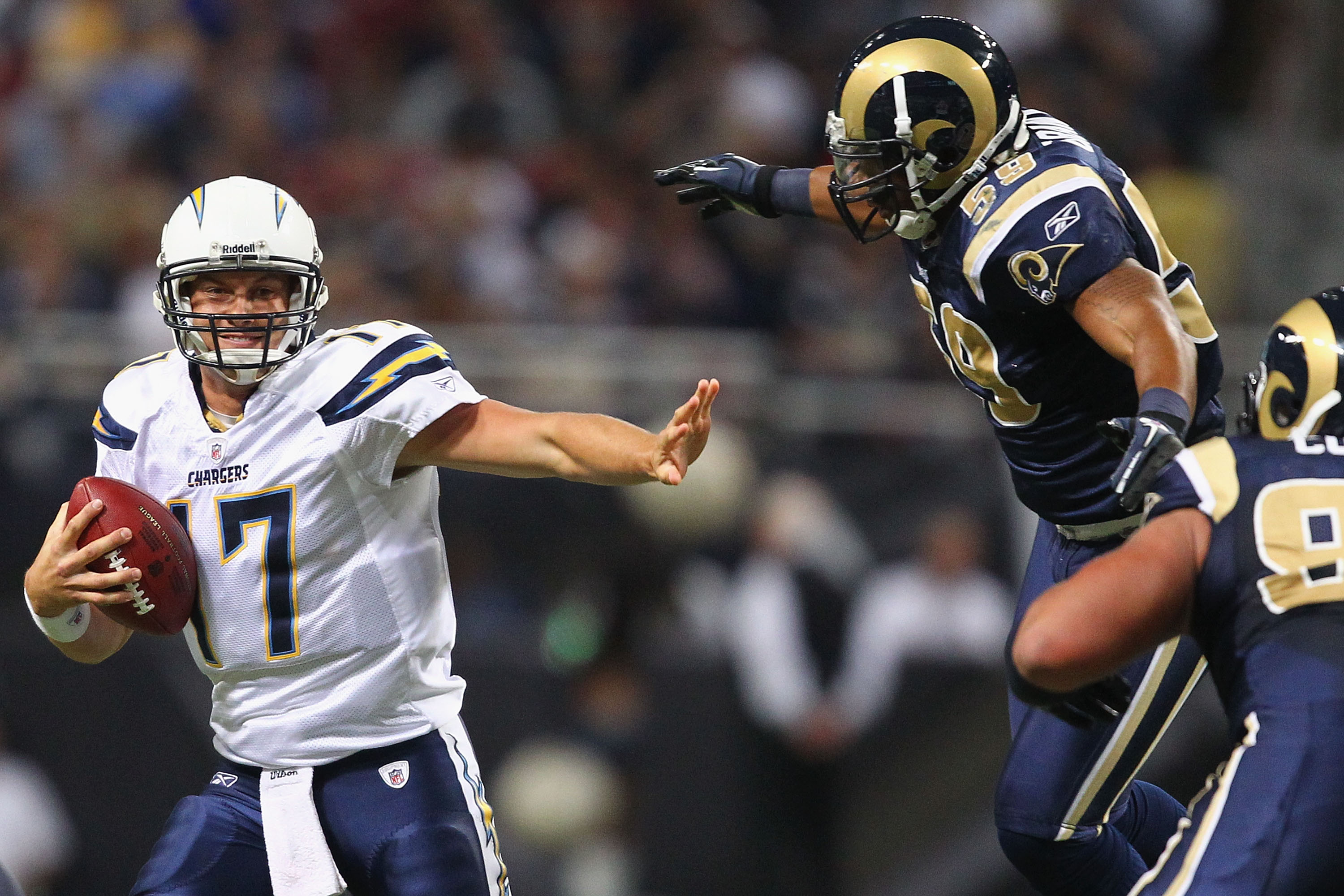 ST. LOUIS - OCTOBER 17: Philip Rivers #17 of the San Diego Chargers looks to avoid getting sacked by James Laurinaitis #55 of the St. Louis Rams at the Edward Jones Dome on October 17, 2010 in St. Louis, Missouri.  The Rams beat the Chargers 20-17.  (Phot