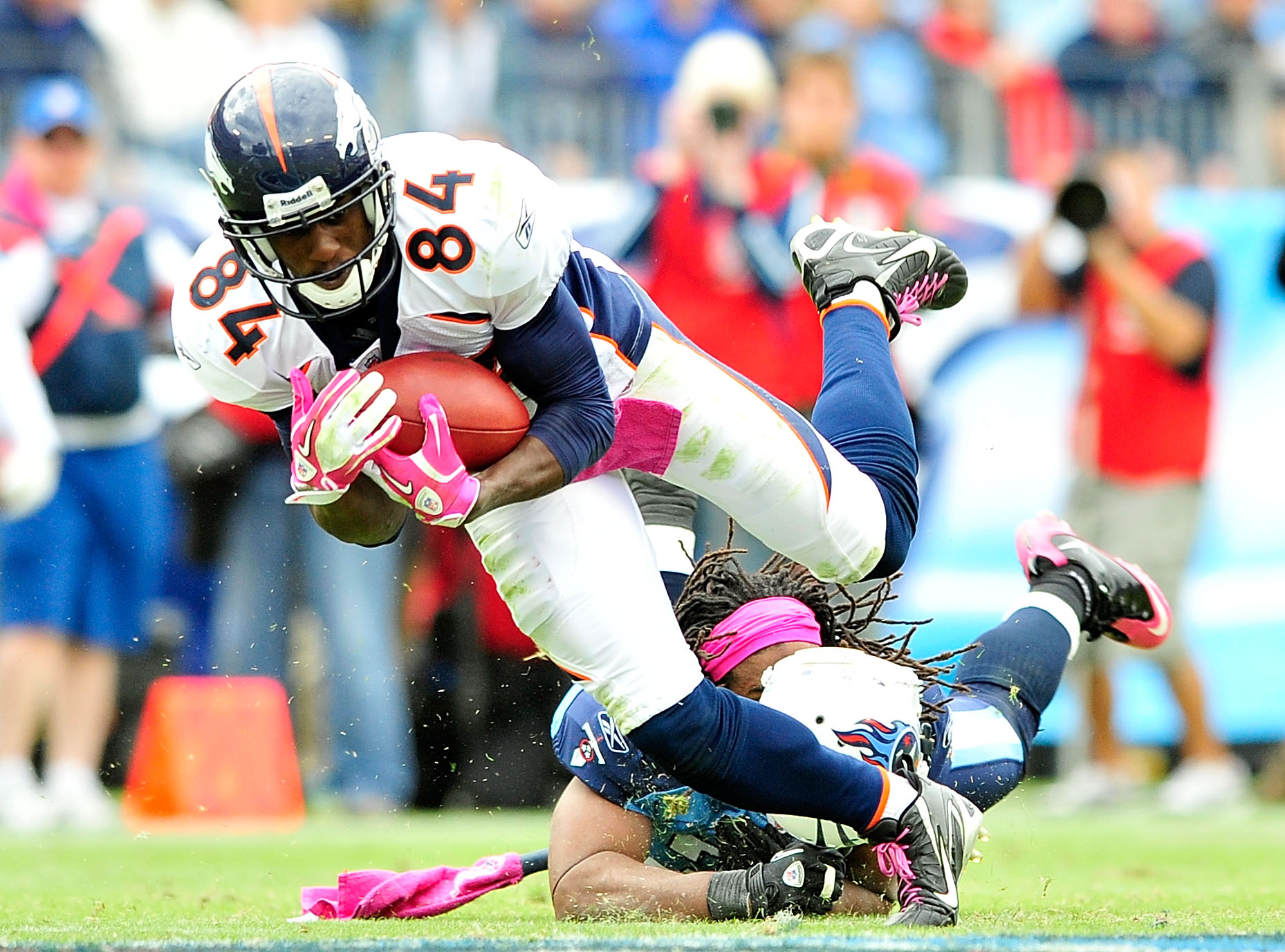 NASHVILLE, TN - OCTOBER 03:  Michael Griffin #33 of the Tennessee Titans loses his helmet as he tackles Brandon Lloyd #84 of the Denver Broncos at LP Field on October 3, 2010 in Nashville, Tennessee. Denver won 26-20.  (Photo by Grant Halverson/Getty Imag